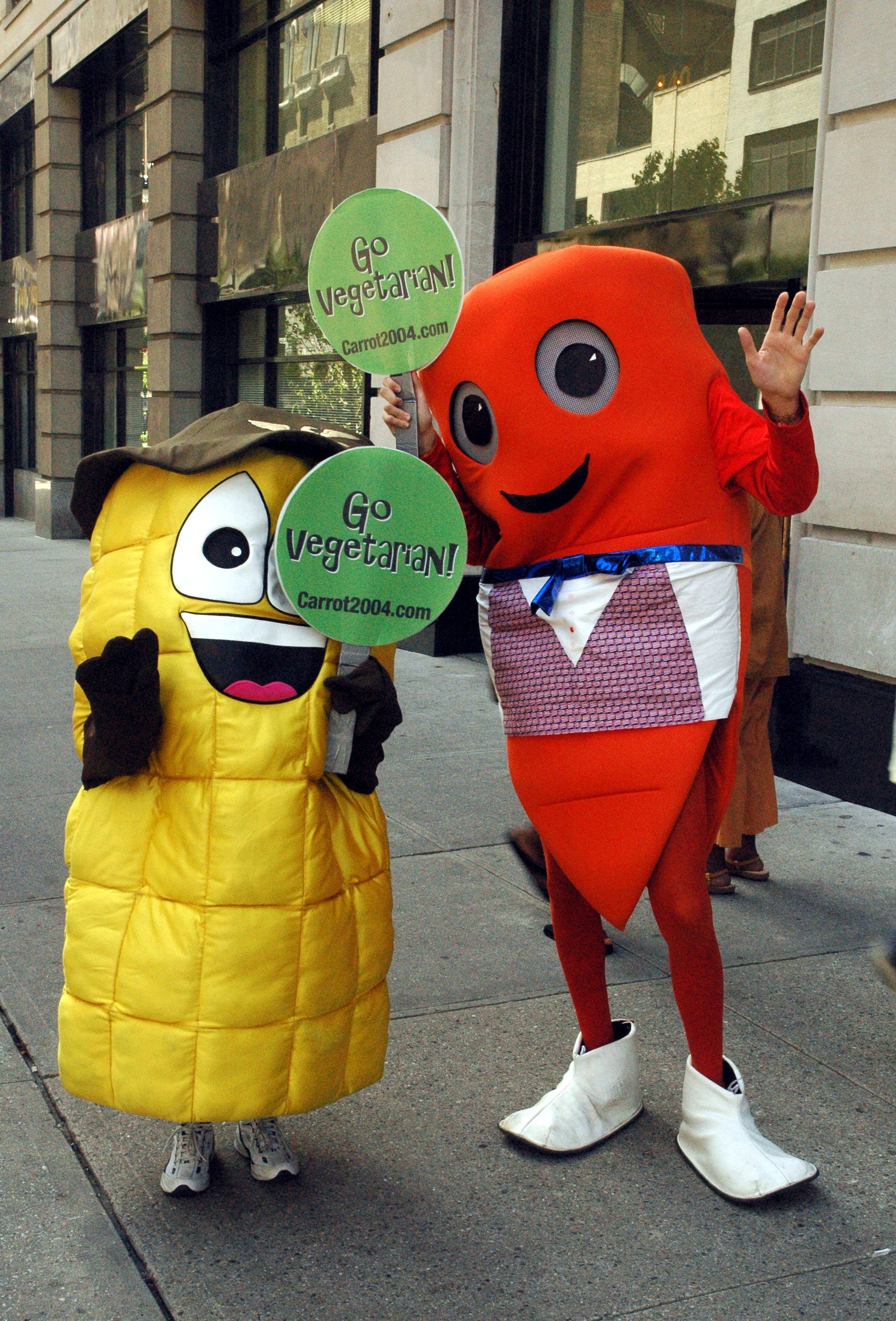 Two cartoon characters pose for photos on 34th Street near t.JPG