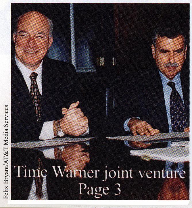AT&T TCI signing.jpg