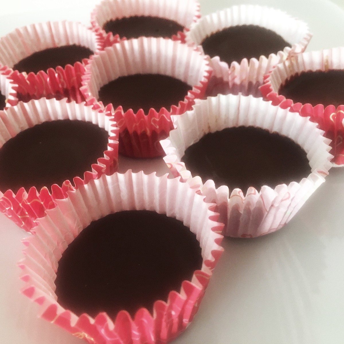 Dark Chocolate Almond Butter Cups       Cup Ingredients:          3/4 cup cacao paste    1/2 cup cacao butter    ½ - 1 cup maple syrup (adjust according to desired sweetness)    1/8 teaspoon sea salt    A few drops stevia (optional)     Filling Ingredients:          1/2 cup raw almond butter    2 teaspoons coconut sugar    1 teaspoon lucuma powder    1/4 teaspoon of sea salt     Directions:          Place cacao paste and cacao butter in a double-broiler to melt.    Remove from heat and stir in maple syrup.    Pour 2 teaspoons (for large cups) or 1 teaspoon (for small cups) of the chocolate into each cup of a lined cupcake tin. Sprinkle with sea salt.    Place tin in freezer for 30 minutes.    Mix filling ingredients together in a bowl.    Remove tin from freezer and scoop almond butter filling, adding 2 teaspoons (for large cups) or 1 teaspoon (for small cups) to each cup.    Place tin in freezer for 30 minutes.    Remove tin from freezer and pour remaining chocolate into each cup, covering the almond butter filling. Sprinkle with sea salt.    Place tin in freezer for at least 6 hours before serving. Allow to warm to room temperature (5 - 10 minutes) for best flavor.     Yields: 6 large or 12 small cups        If you liked this recipe...consider joining the Thryve Studio DIY Chocolate Truffle Making class happening this weekend. Perfect Valentine's activity to celebrate the occasion. See flyer for sign up details below.