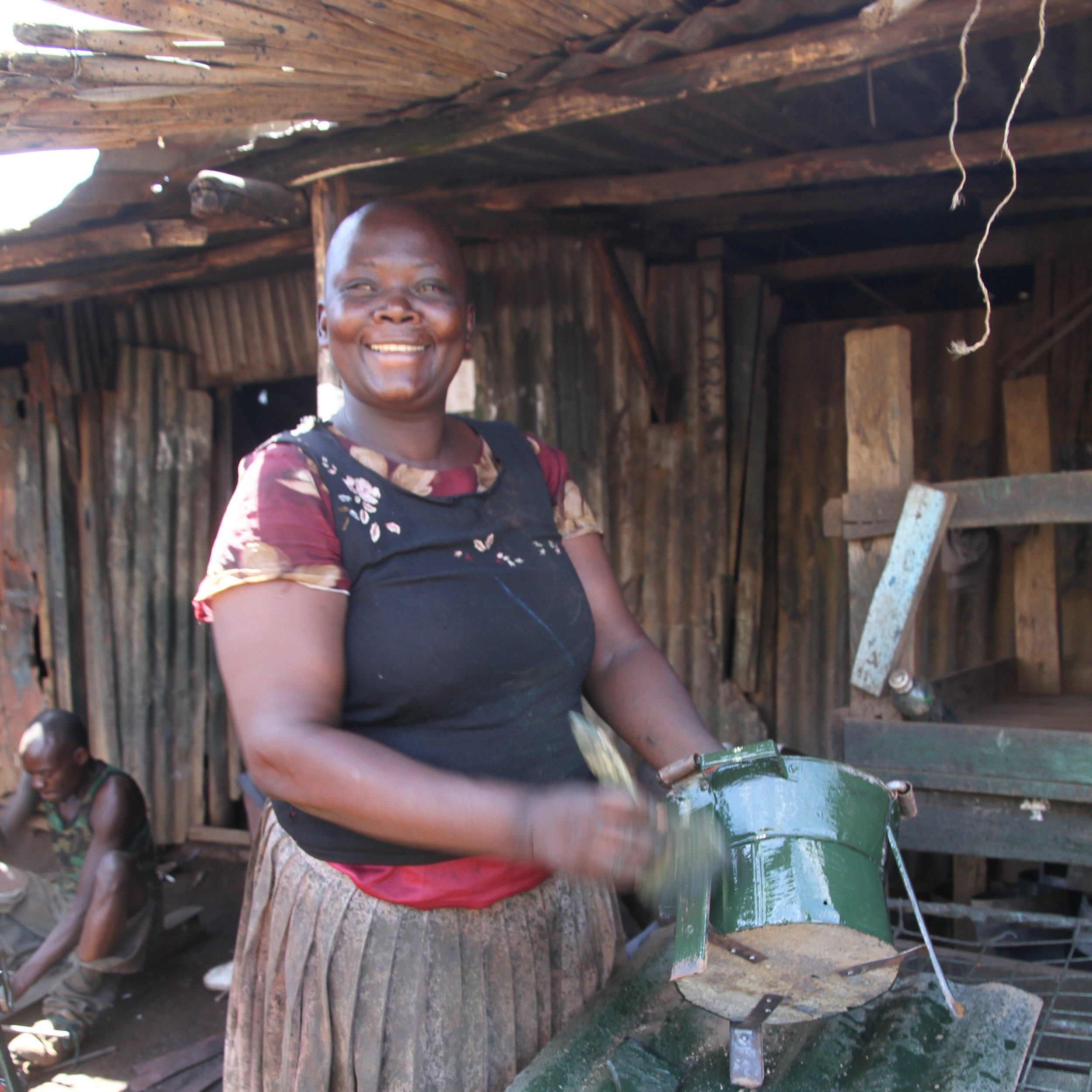 Hi, I'm Eunice - With your support, I hope to earn more income to provide for my teenage sons and hire members of my community to help my stove business.