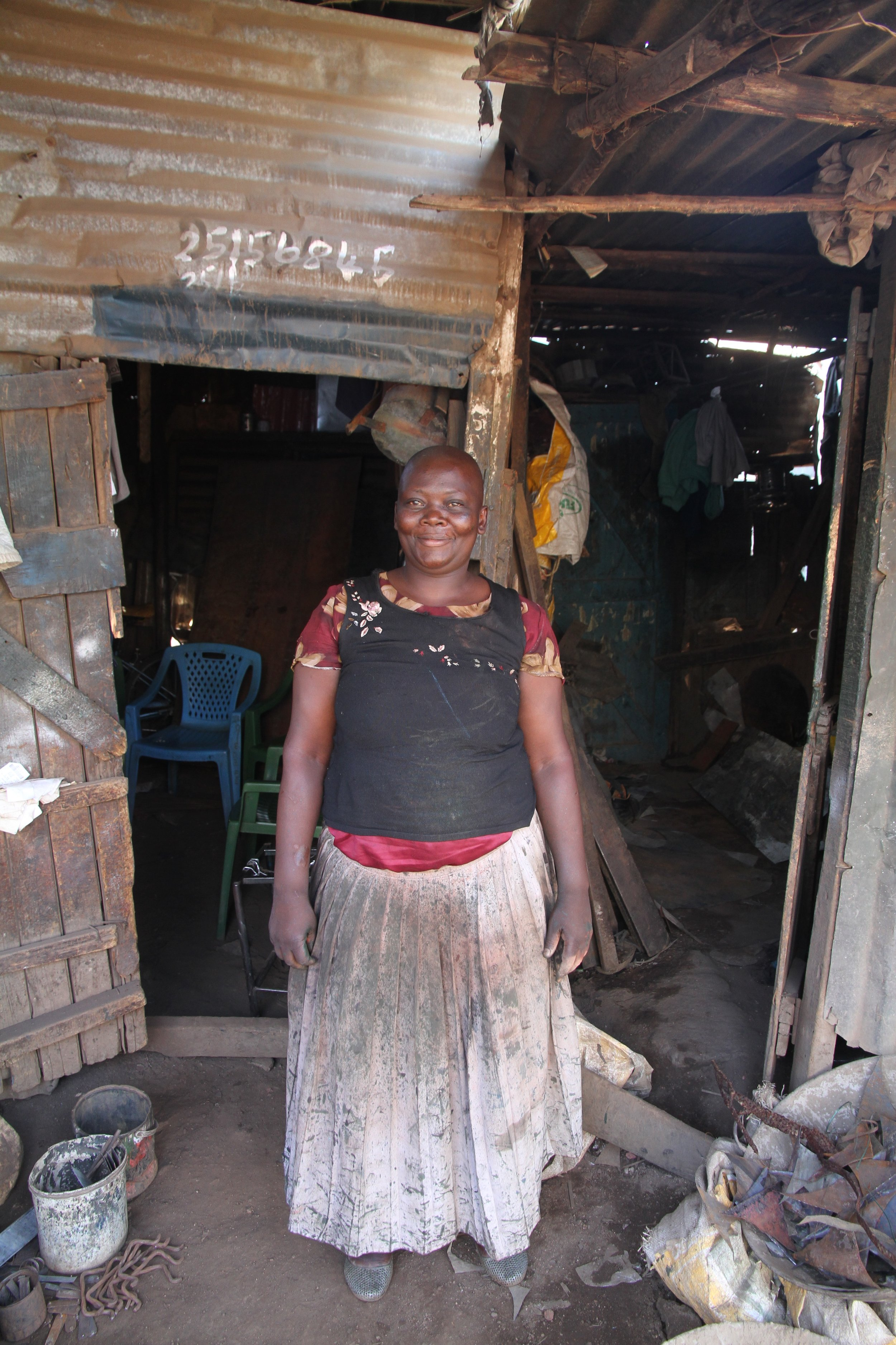 Eunice in front of her shop