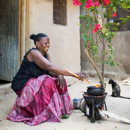 Rahel cooking with one of her stoves