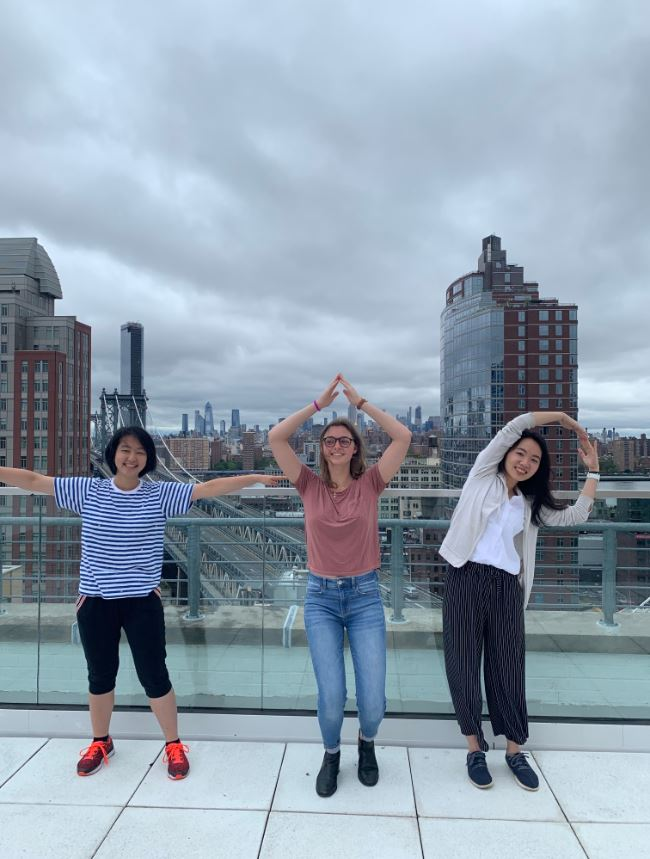 "Li Yin, Cloé, and Yu-Ting (from left to right) spelling ""TAP"" with their arms!"