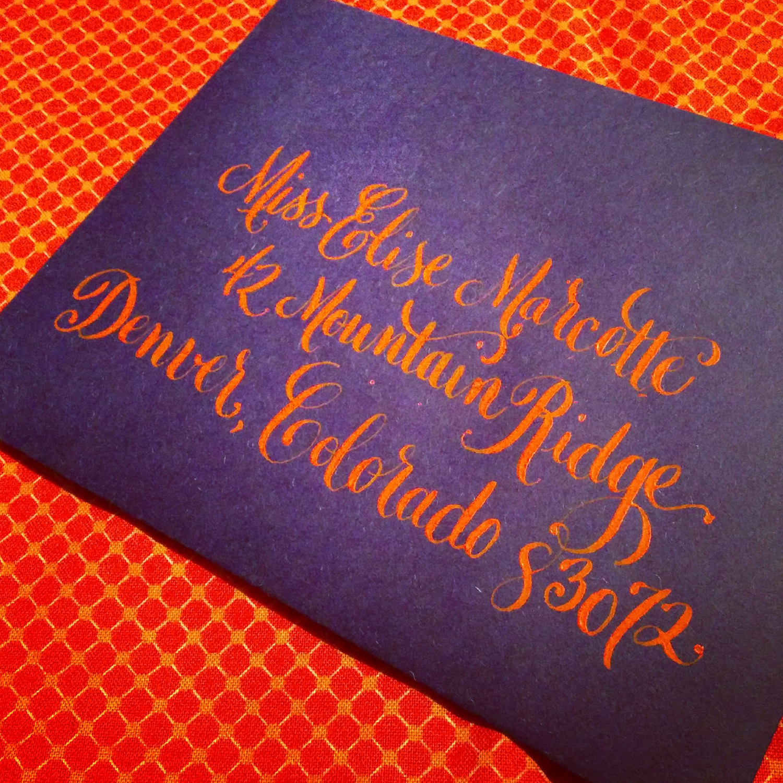 calligraphy-envelope-barcelona-orange-ink-on-indigo.jpg