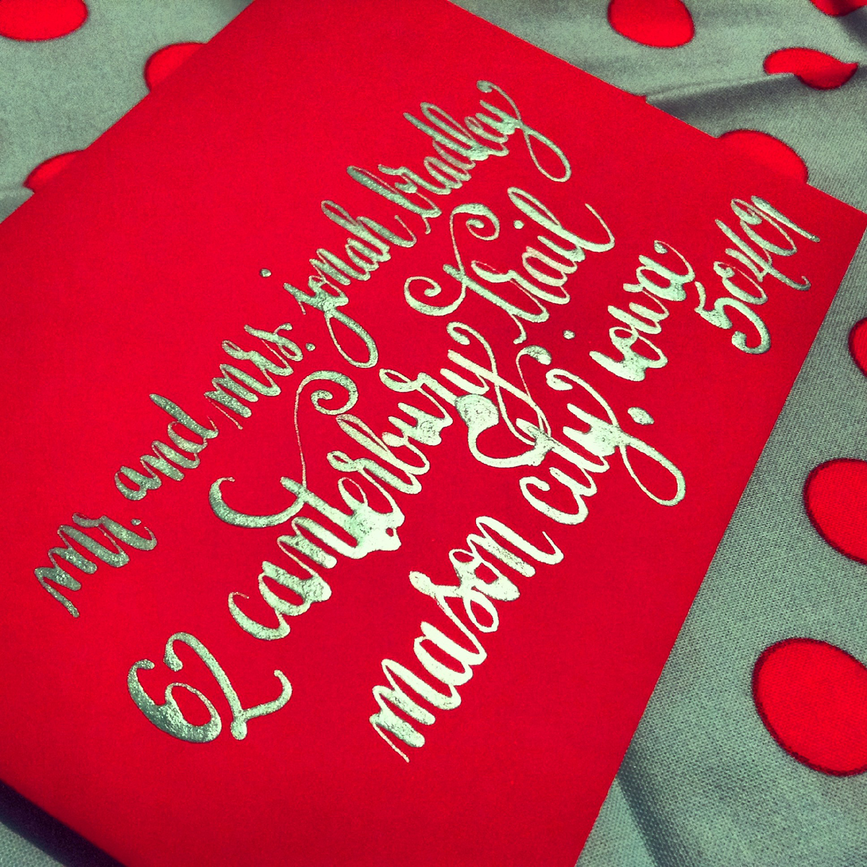 calligraphy-envelope-barcelona-metallic-teal-ink-on-red.jpg