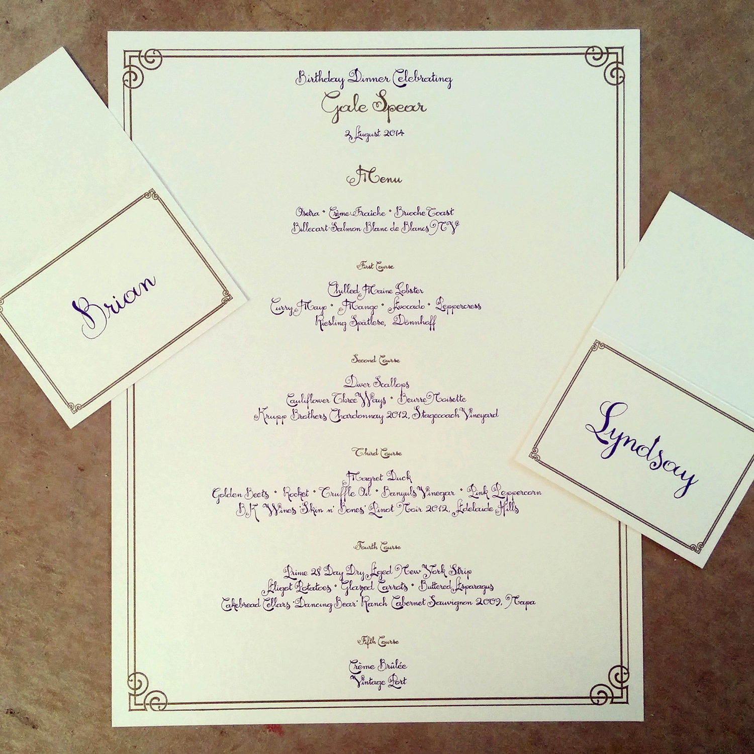 calligraphy-menu-and-place-cards-custom-lettering-purple-and-gold-thermography-on-ivory-metallic.jpg