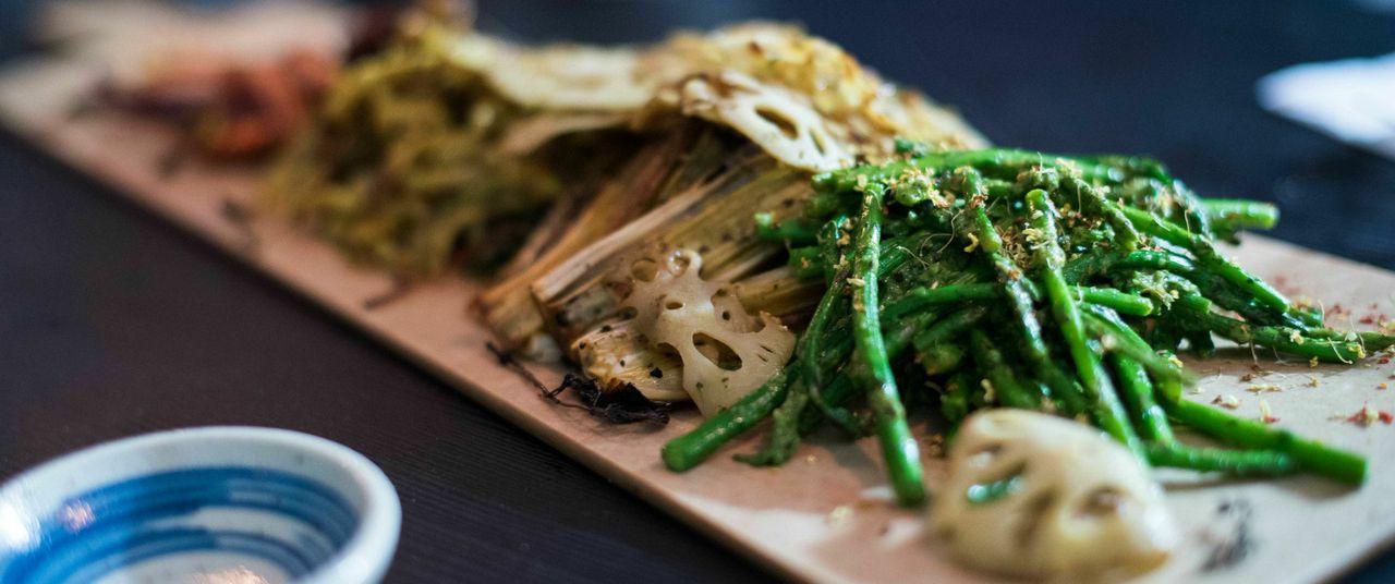 Hot-bean pickled kale, turmeric-roasted fennel, tarragon lotus root, thyme-roasted rainbow carrots, black sesame miso mushrooms, and asparagus in watercress-sesame sauce