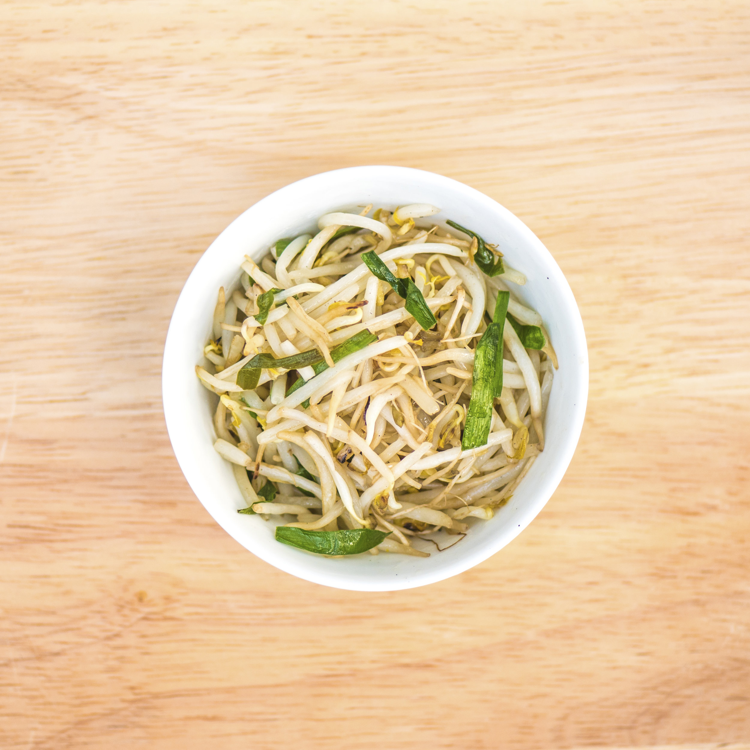 beansprouts   Stir-fried with Chinese chives with a little white pepper and rice vinegar, in a wok. For most chun bings, we recommend having beansprouts as a base.