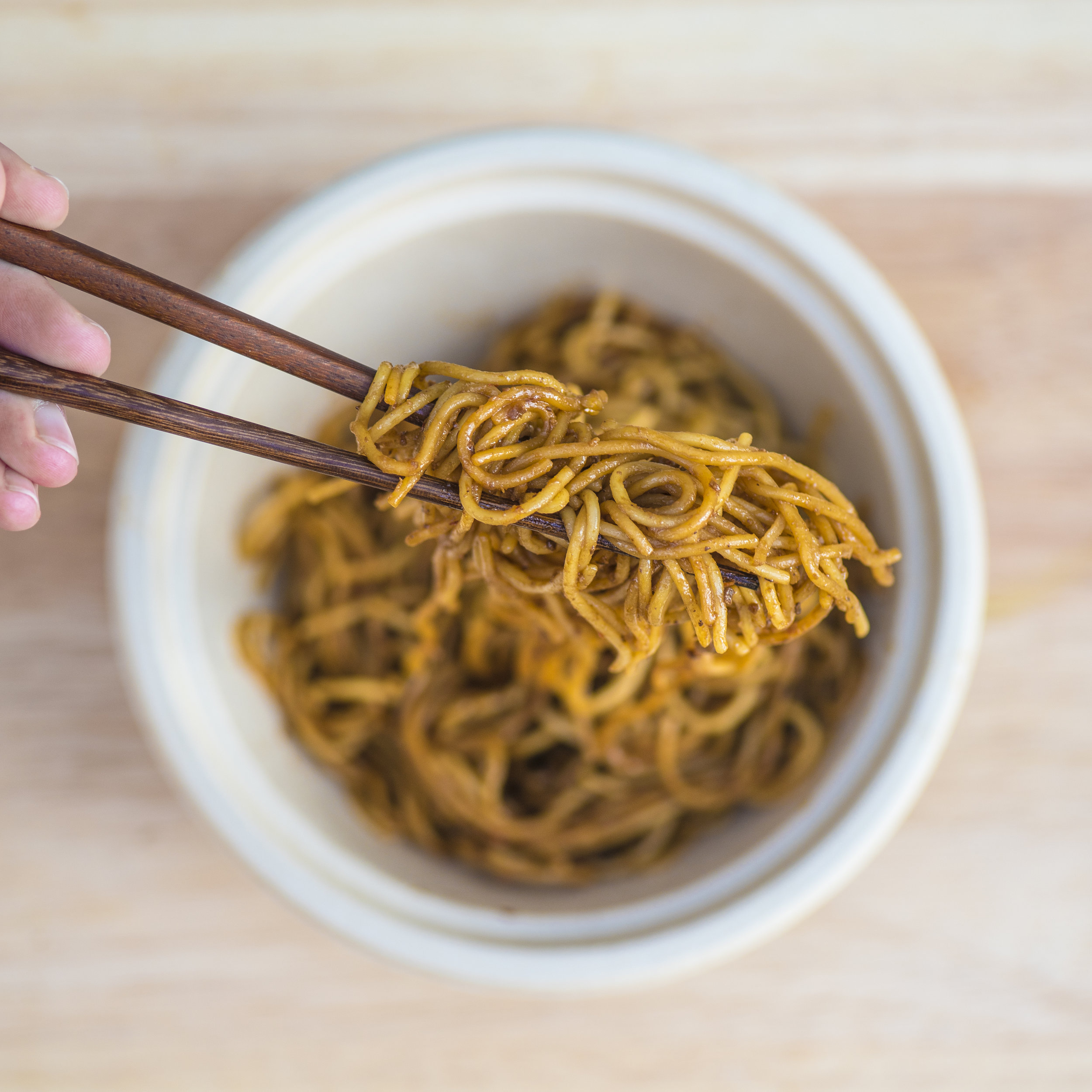 "jaja  Jaja is our take on ""zhajiang noodles,"" or fried sauce noodles—perhaps the most representative dish of Beijing. Fermented black beans and soy bean paste are mixed and fried in ginger scallion oil until fragrant, then blended into a paste."