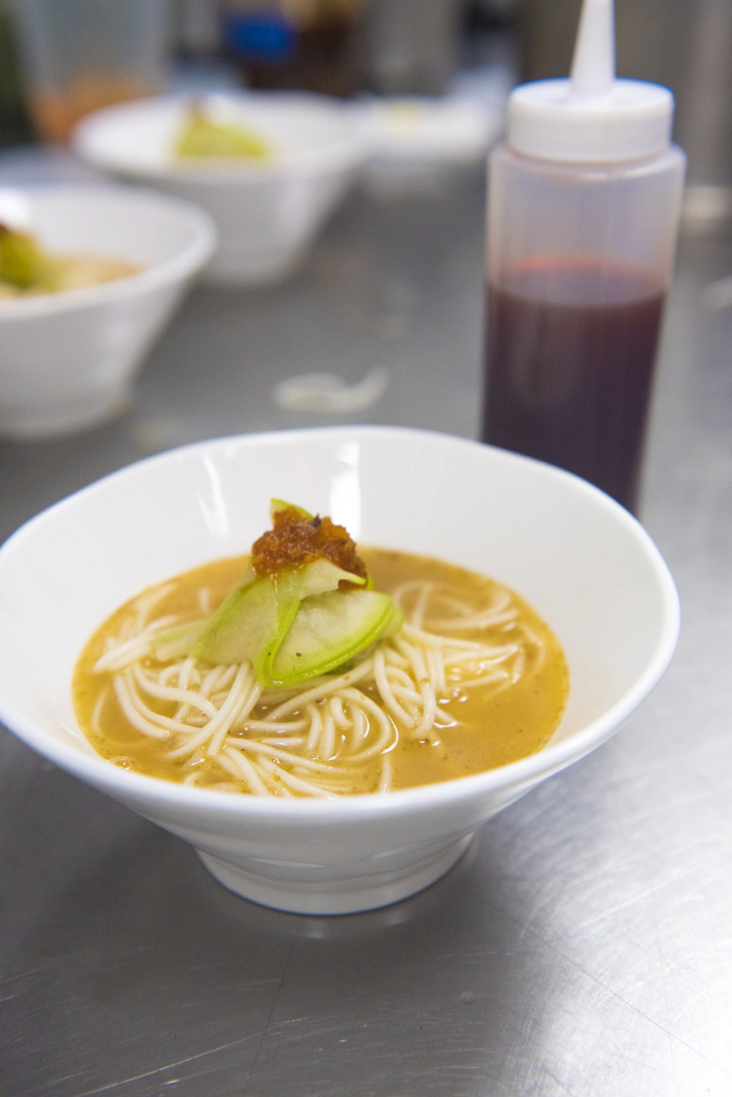 The 4th course: hanging noodles in duck and mutton broth with sweet melon, plus a touch of red vinegar