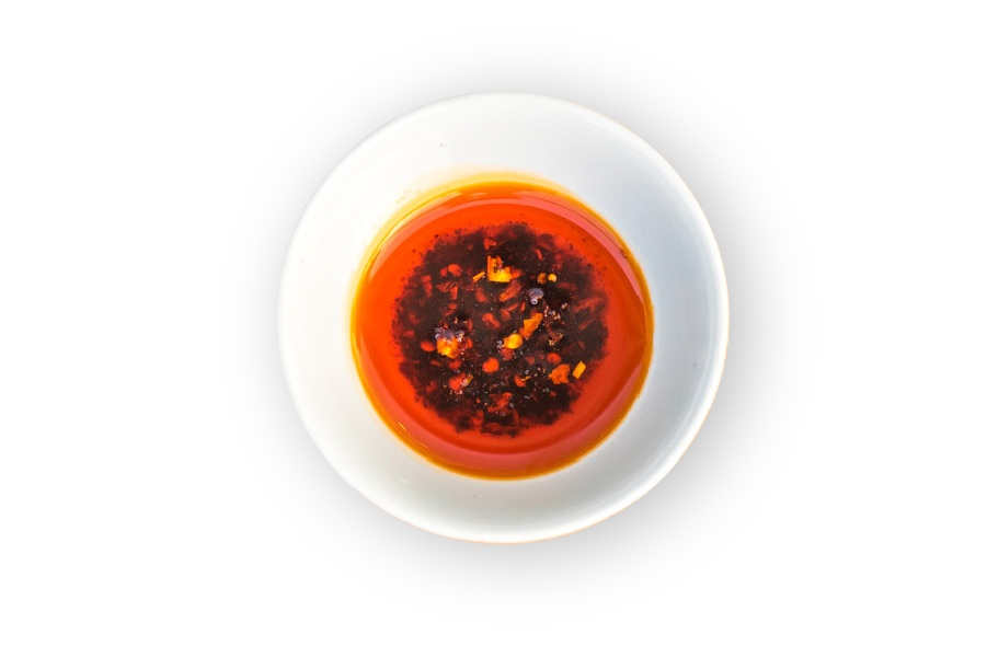 chili oil   Almost all Chinese restaurants either carry sriracha or make their chili oil. At Junzi, we make ours with Tianjin chilies, sichuan peppercorns, and smoky cayenne. This is the garnish we recommend to give meals a kick.