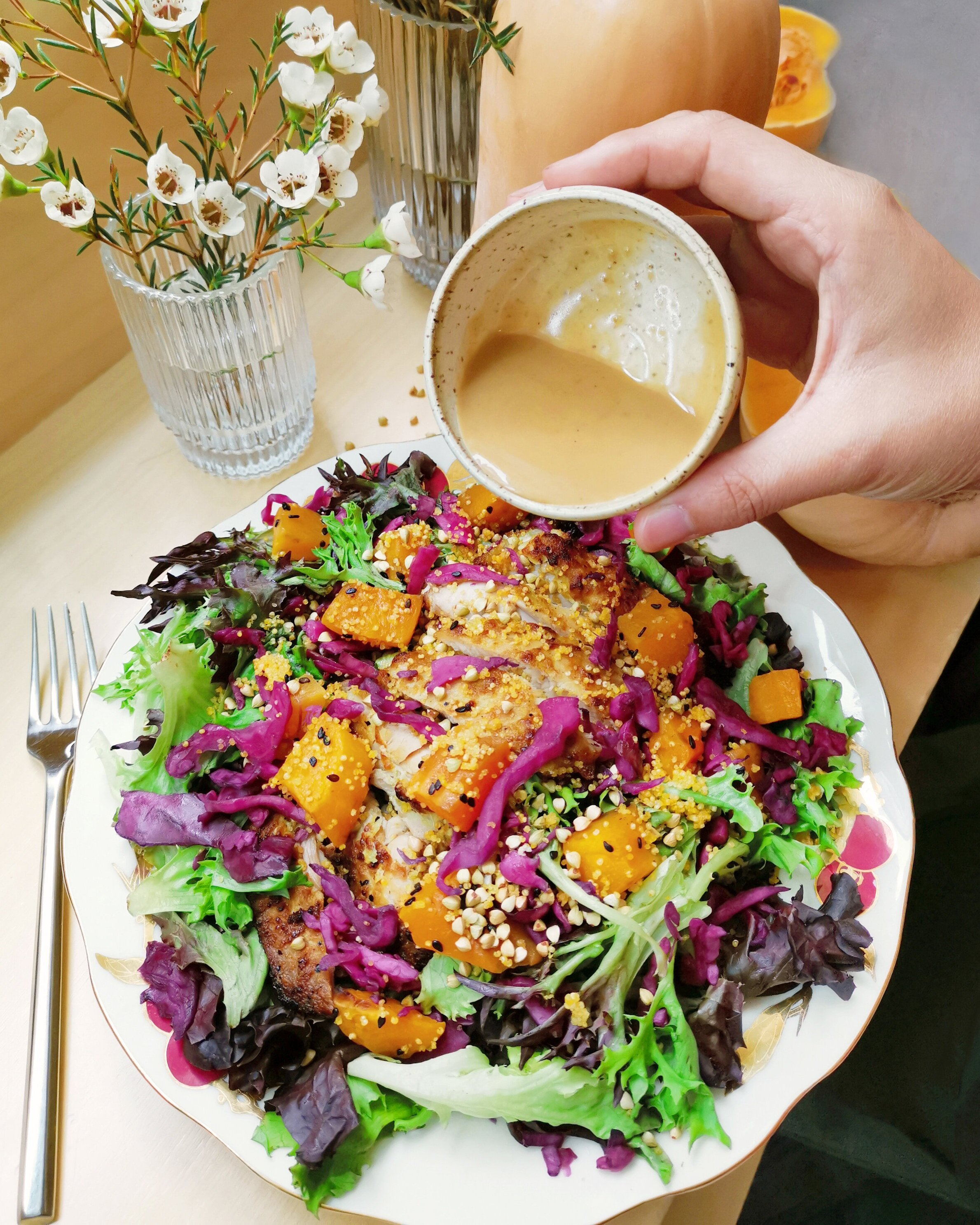 a flavor symphony  Sweet, tangy, and filled with crunch, the Squash & Grain Salad sings a hearty song full of flavor, texture, and color. Ginger scallion chicken, tangy pickled cabbage, and rich roasted squash are balanced with a delicate base of young lettuce.