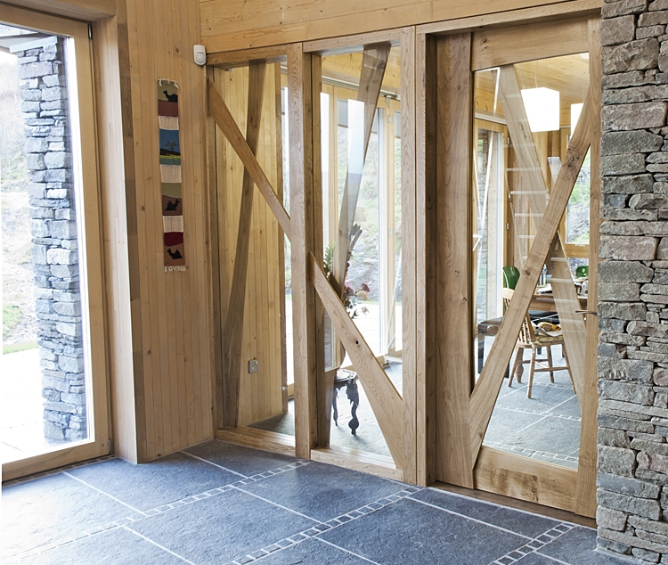 Glazed screen in oak and spalted beech allows light to flood into the lobby and kitchen.