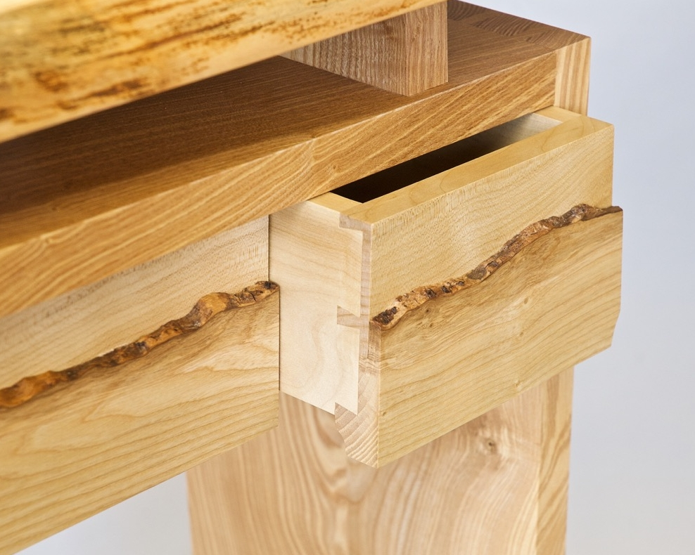 Console table drawer open showing half blind dovetails.