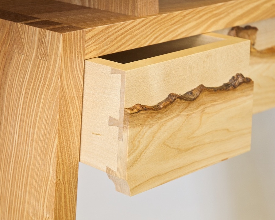 Olive ash table frame, sycamore drawer box and natural edge ash veneer.