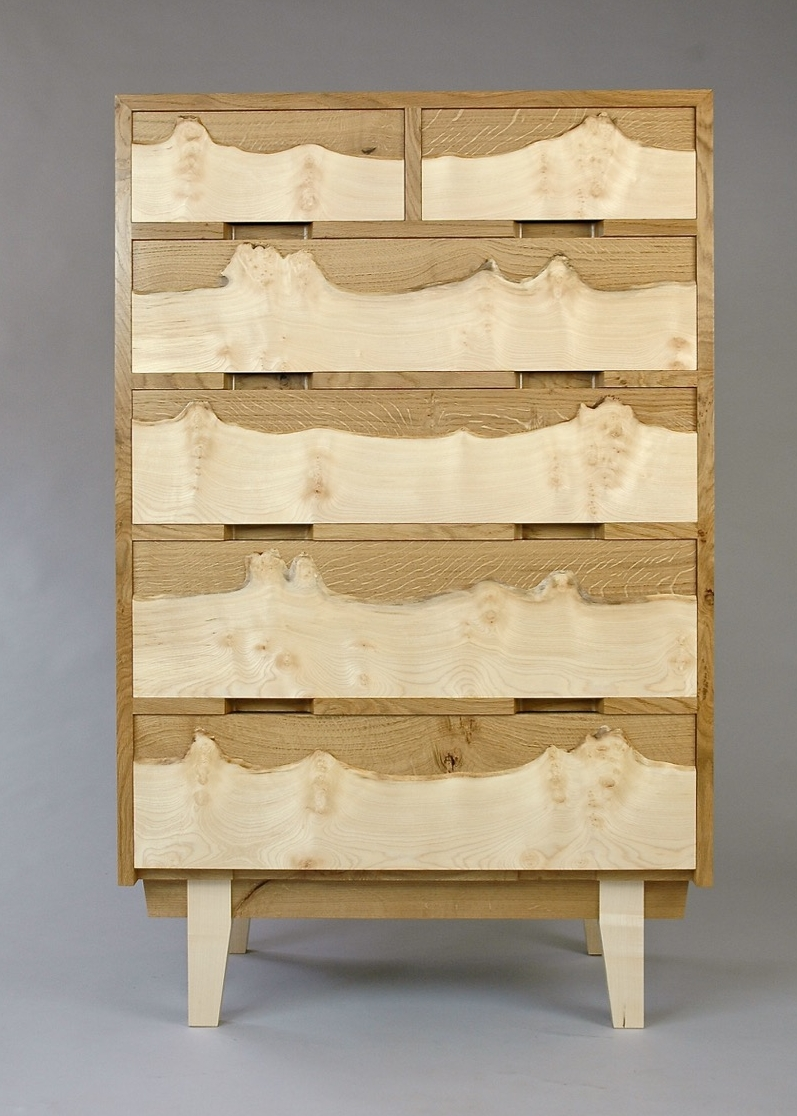 Matched veneers on the first, third & fifth and second and fourth drawers