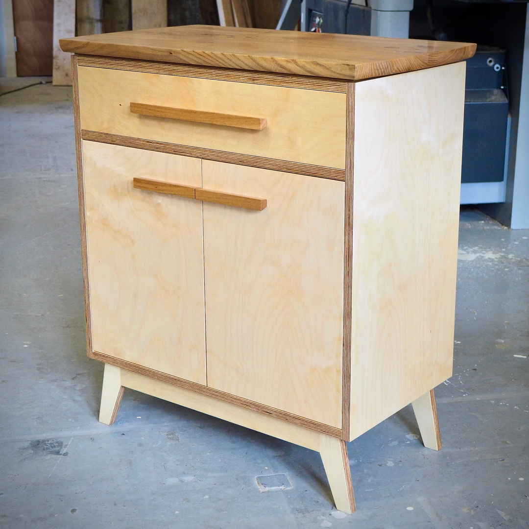 Compact mid century styled cabinet