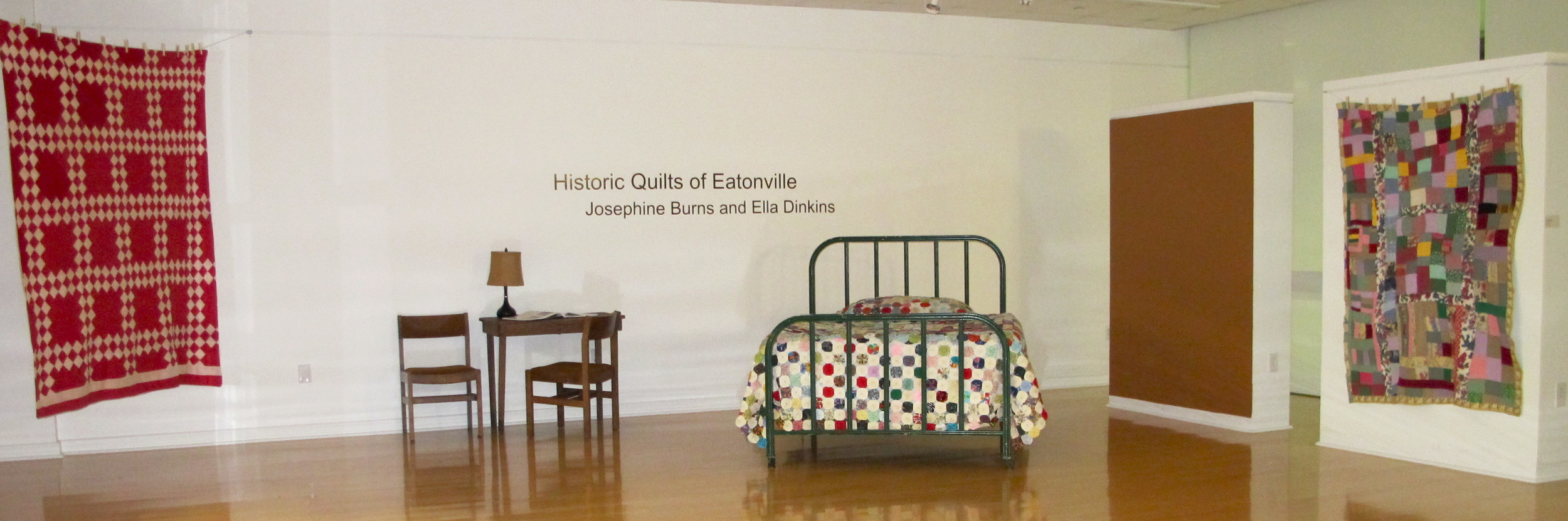 "Above the Fray ,  Historic Quilts of Eatonville  | Hand-stitched Quilts by Josephine Burns and Ella Dinkins   Below right  | works by Stacy Rosende in  subSURFACE;  additional view featured on HOME page.   Below left  |  Sacred Folk  as curated in Gallery 221@HCC; colorful painting by Lila Graves; chair and portraits by Butch Anthony   Esther Hammer | Tampa Tribune  ""Called 'Sacred Folk,' the exhibit presents more than 50 pieces of folk art by 20 Southeastern folk artists [on loan from Jeanine Taylor Folk Art]...  'Jeanine and I have been doing this for about 10 years,' says Gibson. 'In 2002 we jointly hosted an exhibit at the former Matthews Art Gallery in Tampa. There was a tremendous response to it and we realized a lot of people in Tampa had an interest in folk art… I repeat artists but never their work so that keeps it fresh for me too.' """