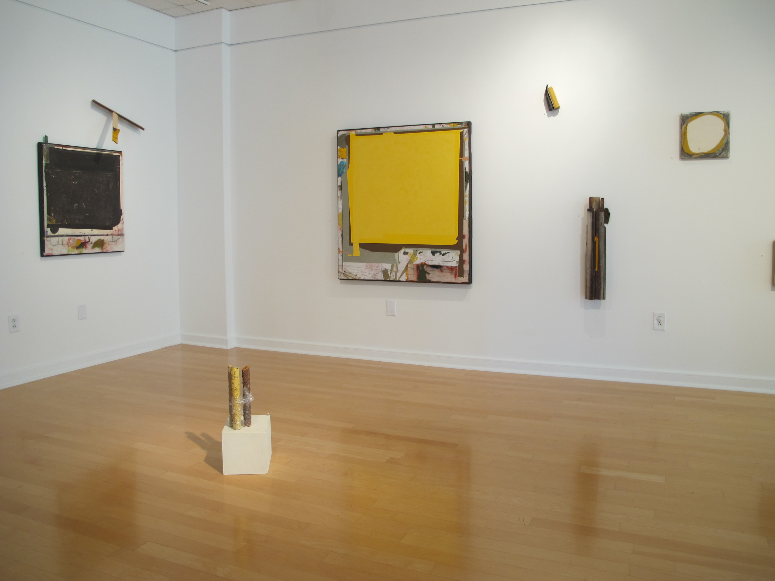 Community of Flat Faces , mixed media works by Edgar Sanchez Cumbas, in Gallery 221@HCC; see review below.