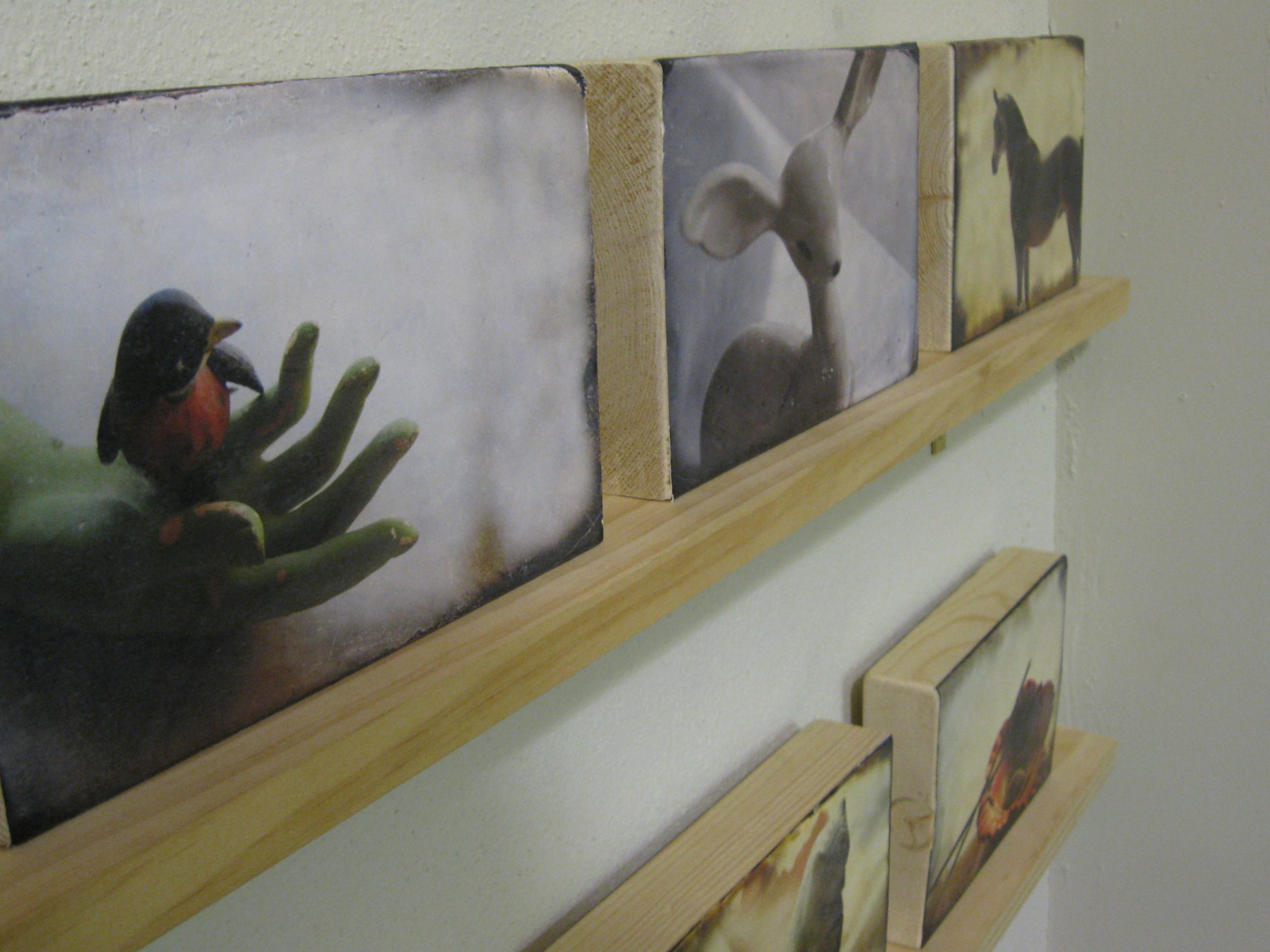 Series of photo transfers on wood block by Raydel Shanks