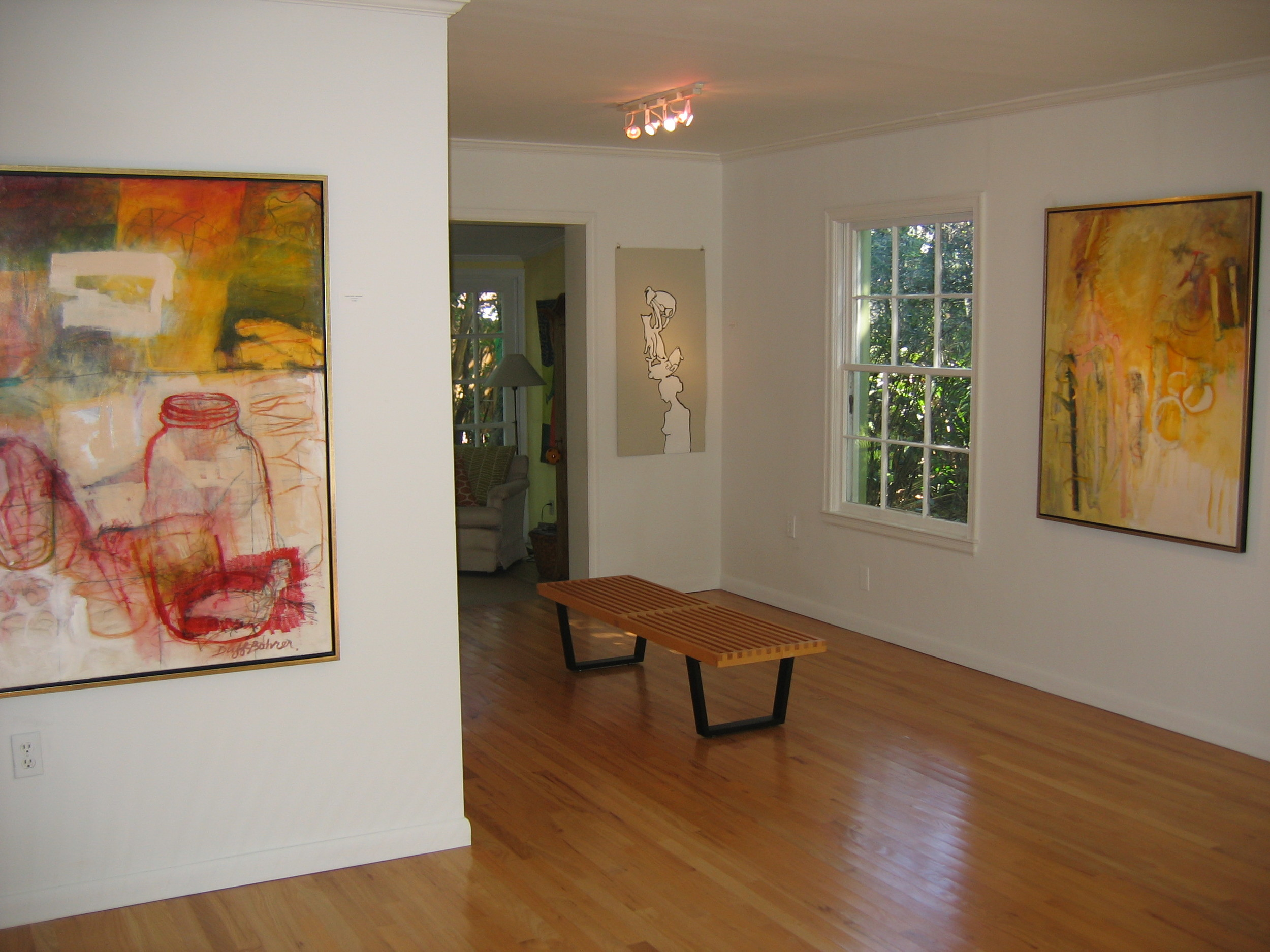 Joan Duff-Bohrer, above and far right; Tracy Midulla Reller, on paper in middle; shown as part of an Art House 3rd Thursday open house.
