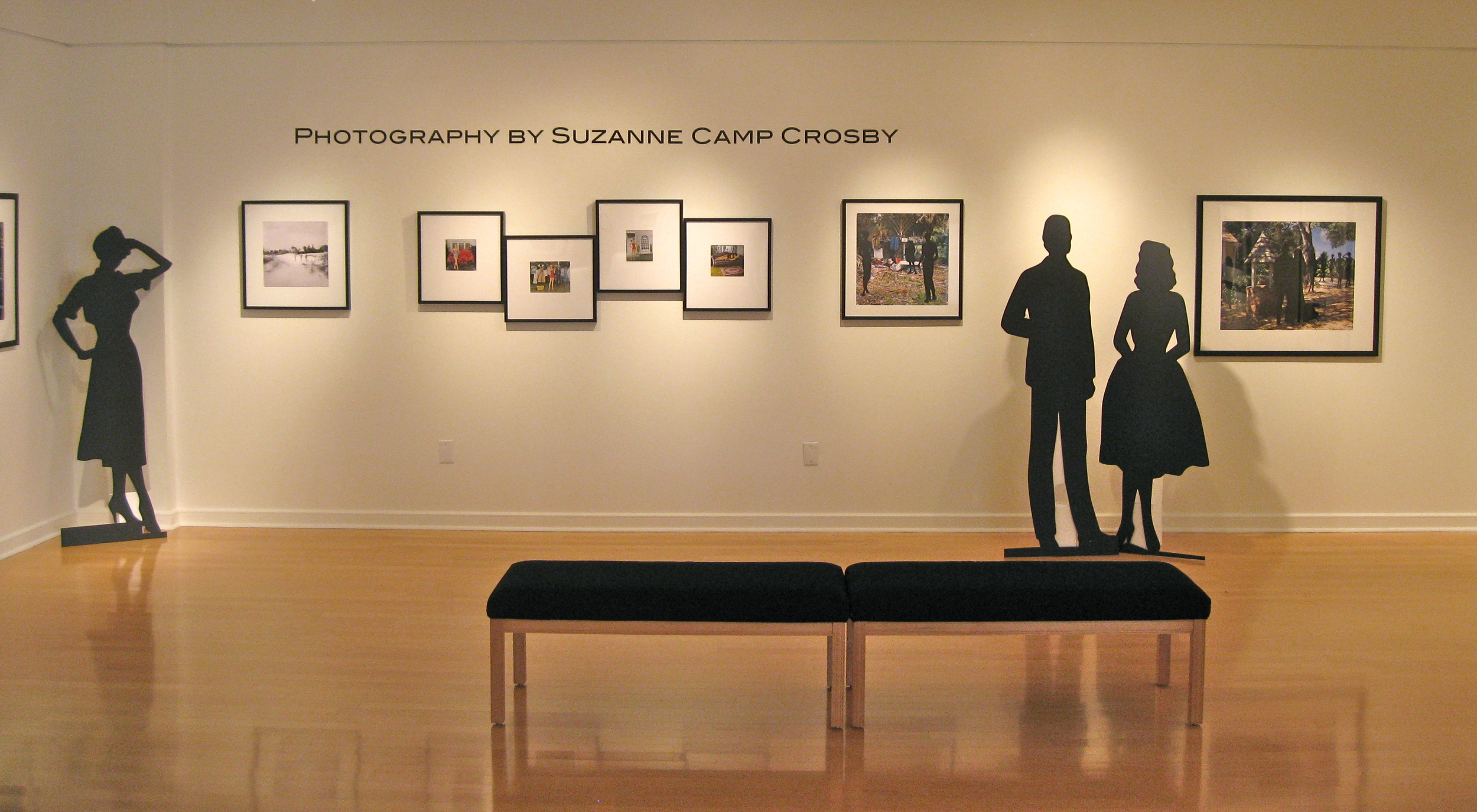 Suzanne Figures  featured over 40 pieces by Suzanne Camp Crosby, of or relating to figures. Life-sized versions of her antique paper dolls were created to stand alongside their framed counterparts - as seen in Gallery 221@HCC, 2013 Spring, Dale Mabry campus - curated and designed by Katherine Gibson.