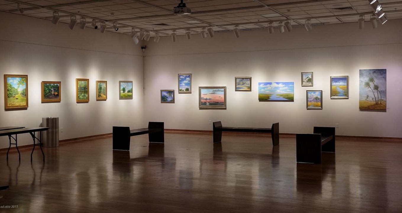 Photographs above and below courtesy of Ed Okie. Florida Landscapes, recent works by Jayne Crews Linton, as seen in the Polk State College Lake Wales Art Center. Placed and installed by Kathy Gibson. A lovely opening, generously supported by a wonderful community, complete with champagne cocktails!