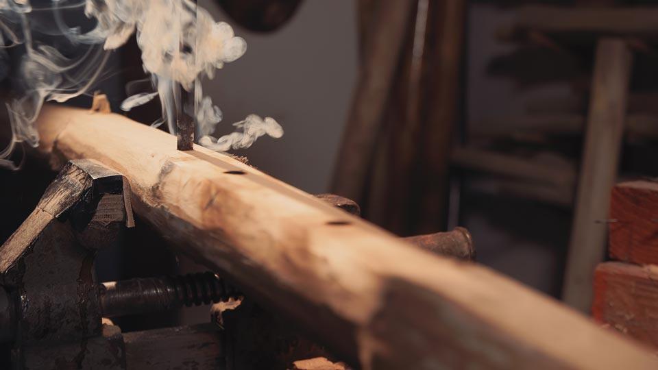 master-flute-maker-winne-clement-fluiten-luthier-craftsman-facteur-flûtes-flöten-hersteller-music-instrument-wood-wind--burning-sound-holes.jpg