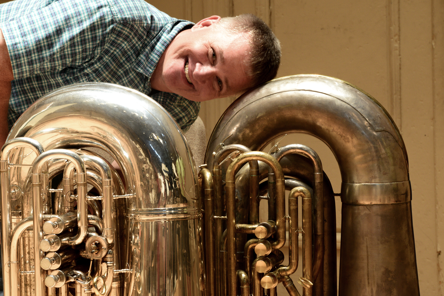 Mike Roylance poses midweek with the two tubas he tried out for Tchaikovsky No. 6.  (Left to Right) Nirschl 6/4 CC and 1920's era Holton BBb.