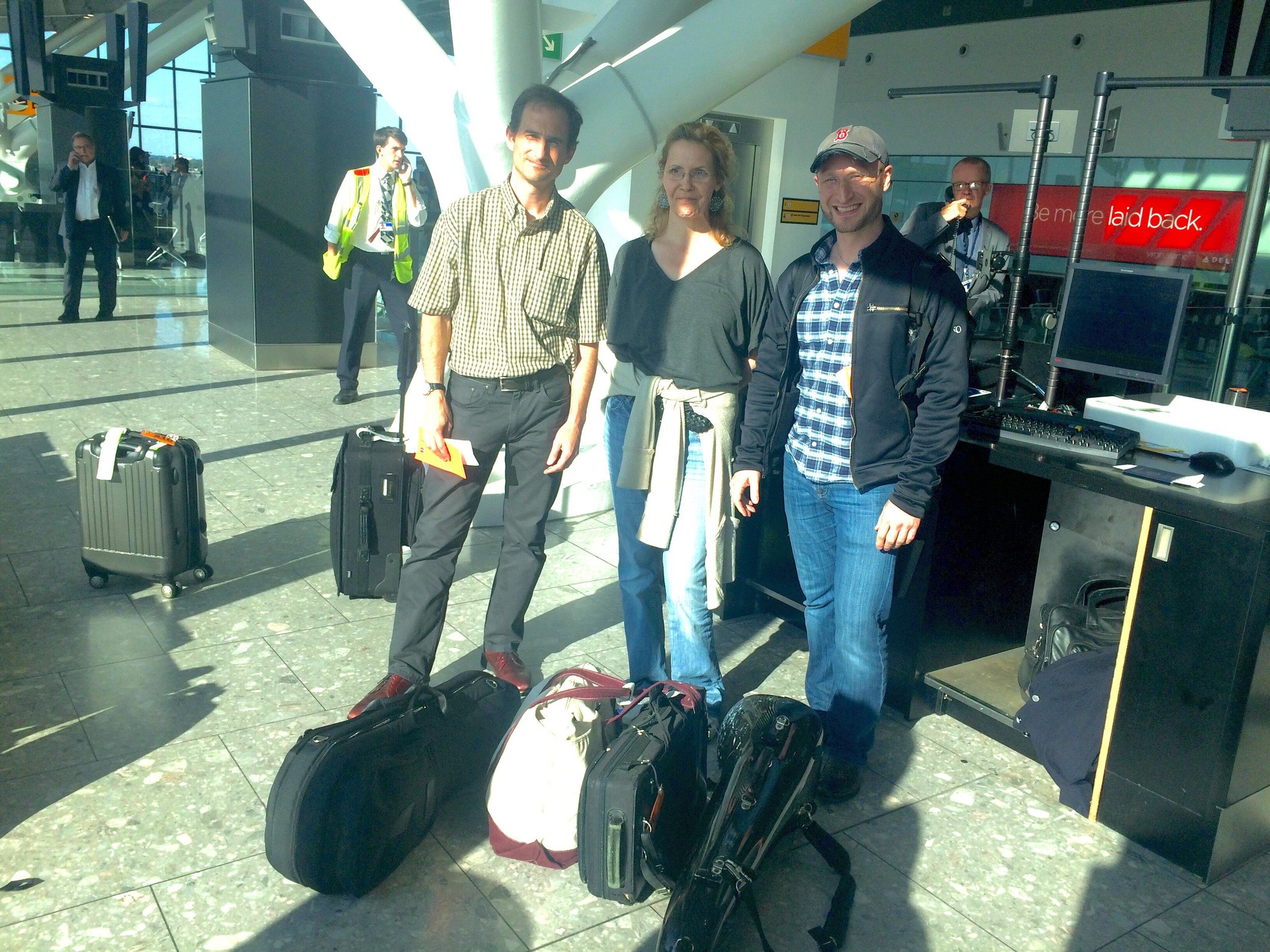 """BSO Musicians and their """"offending instruments"""" at the British Airways terminal waiting to board the flight home."""