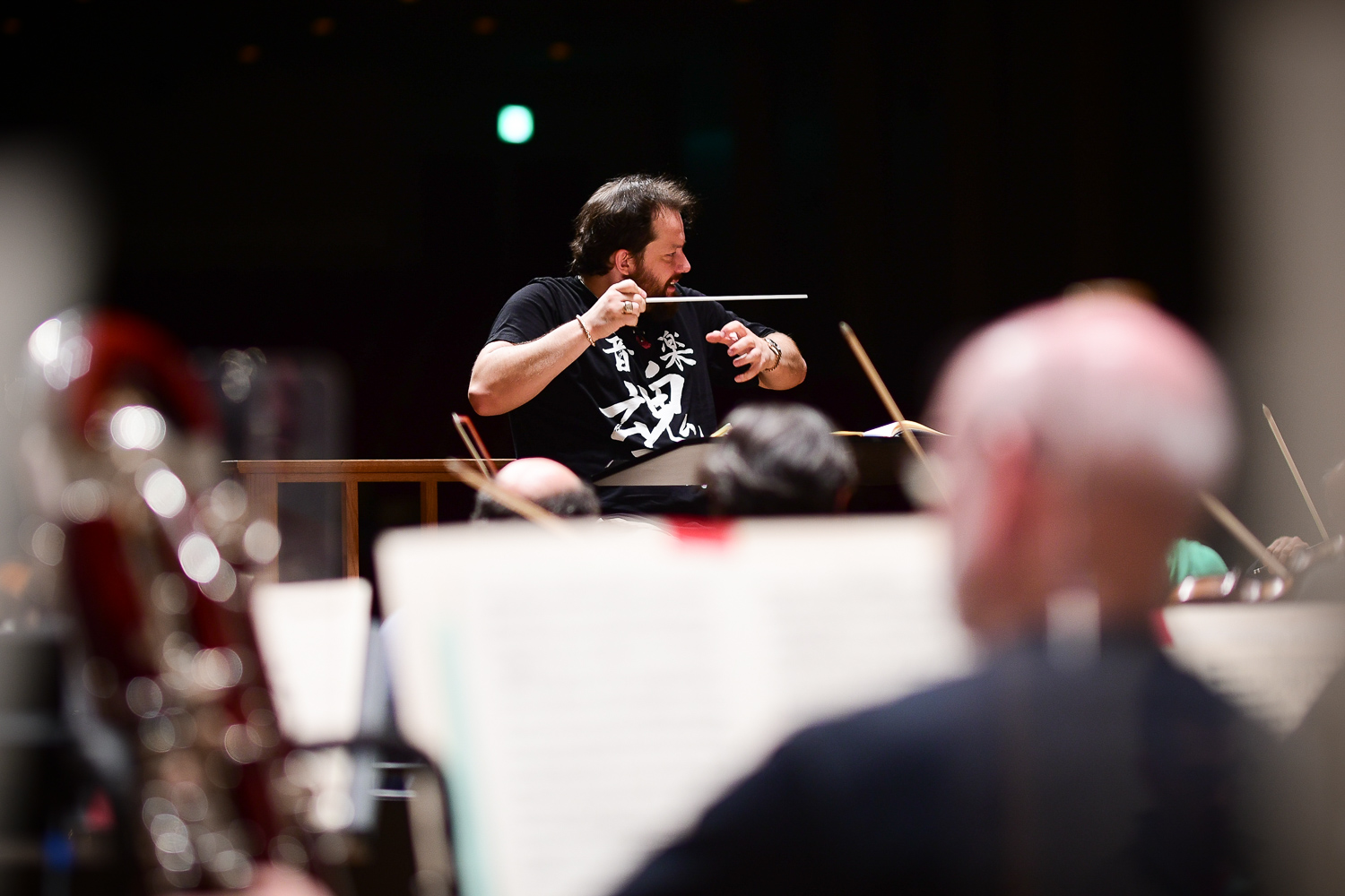 Maestro Andris Nelsons makes eye contact with Violins during sound check for Mahler, No. 1