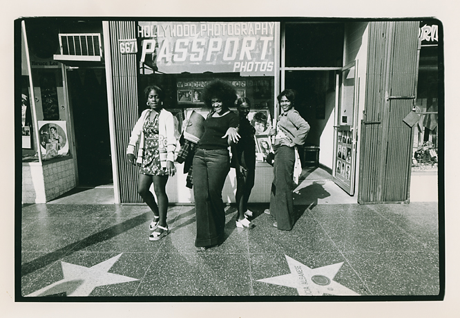 """""""Stylin,"""" Passport Photos, Hollywood Blvd.  , 1974. Vintage gelatin silver print. Signed with the photographer's credit stamp on the print back. Image measures 5 1/2 x 6 1/2 inches. Inventory #PD010.  Terms  