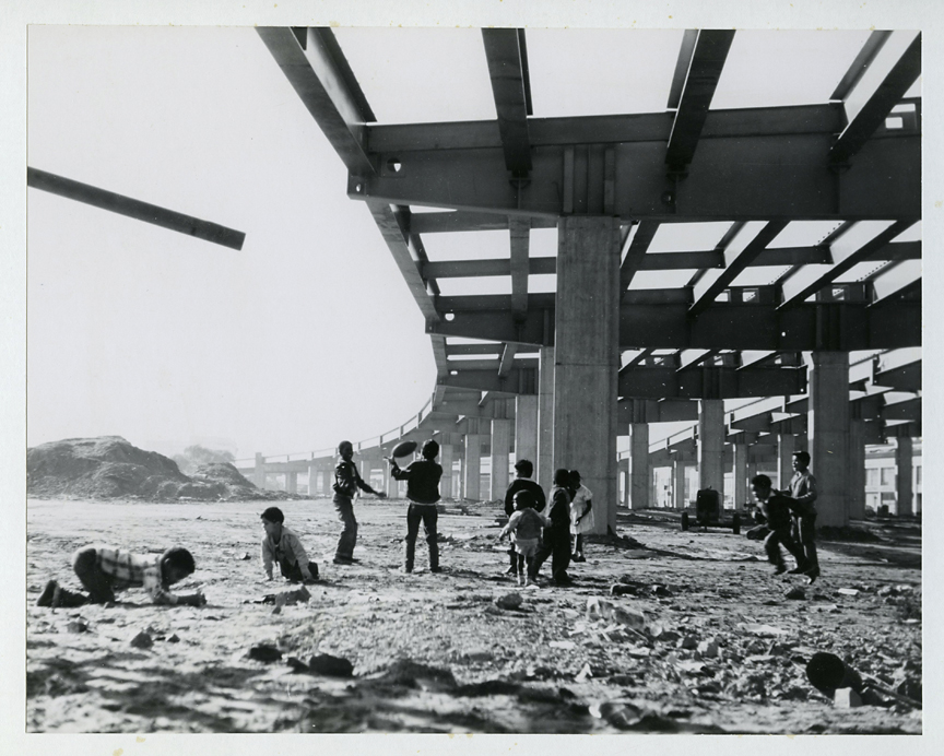 Untitled [Children playing around freeway construction, San Francisco],   1950s. Vintage gelatin silver print, ca. 195os. Image measures 7 1/2 x 9 1/2 inches. Credit stamp on print back and labels on mount back. Inventory #CK002. $2,000.  Terms  |  Inquire