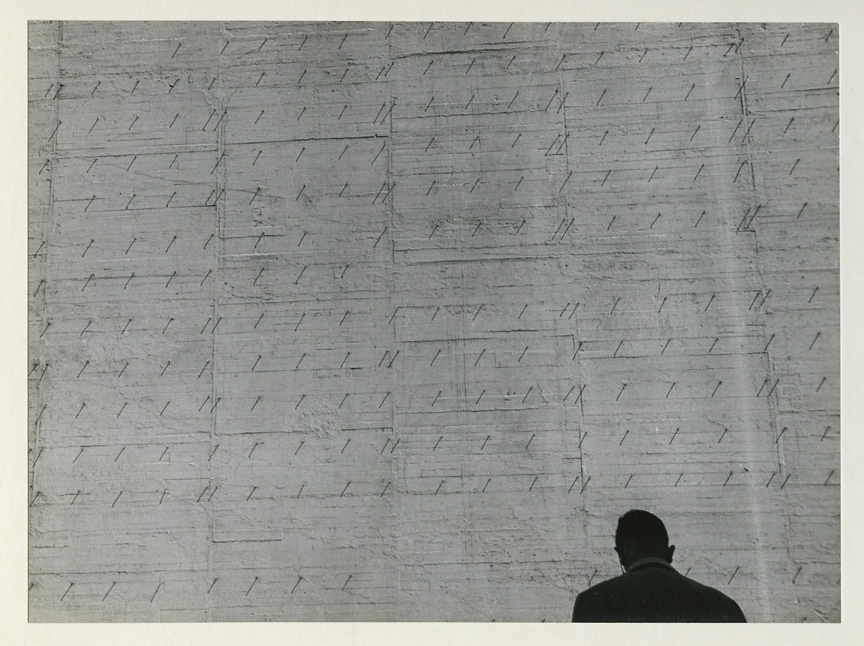 Untitled [Man and concrete wall],   ca. 1950s. Vintage gelatin silver print, ca. 1950s. Image measures 7 1/2 x 9 7/16 inches. Signed in pencil on mount front. Credit stamps on print back. Inventory #CK012. $1,500.  Terms  |  Inquire
