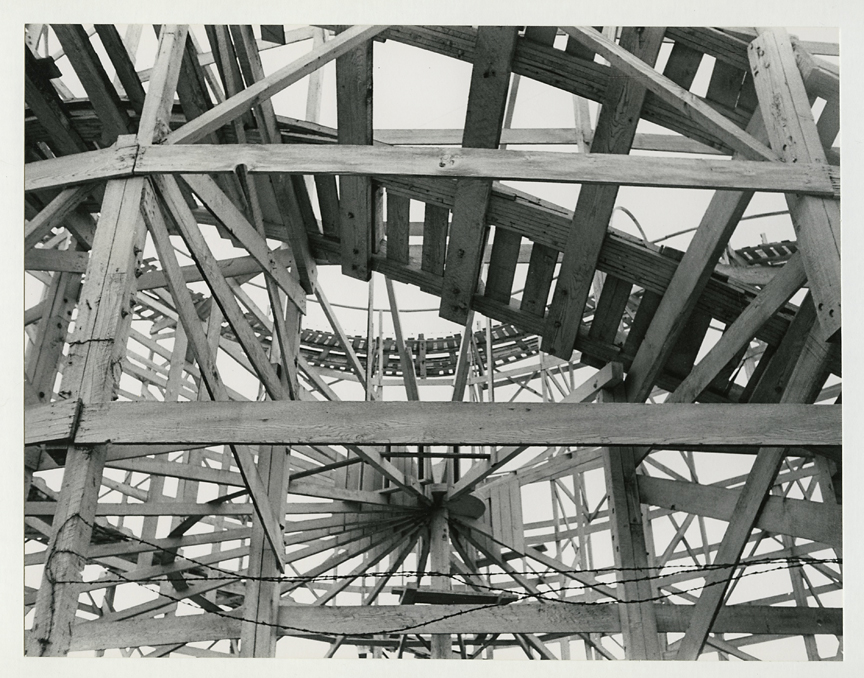 Untitled [under roller coaster],   ca. 1950s. Vintage gelatin silver print, ca. 1950s. Image measures 7 1/2 x 9 7/16 inches. Signed in pencil on mount front. Credit stamps on print back. Inventory #CK015. $1,500.  Terms  |  Inquire