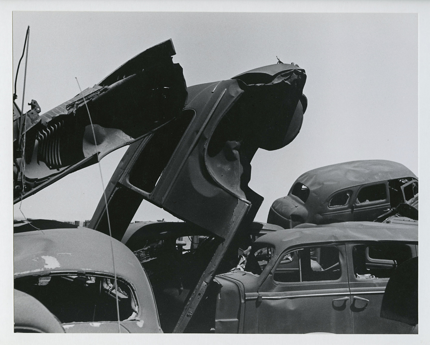 Untitled [junked cars],   ca. 1950s. Vintage gelatin silver print, ca. 1950s. Image measures 7 1/2 x 9 7/16 inches. Signed in pencil on mount front. Credit stamps on moint back. Inventory #CK013. $1,200.  Terms  |  Inquire