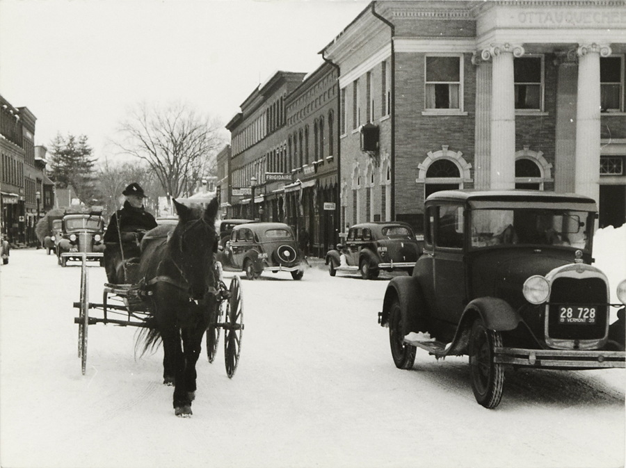 Center of, Woodstock, Vermont on Saturday afternoon after snow storm,   1940. Vintage Gelatin Silver Print, printed ca. 1941. FSA credit stamps on back. Image measures 7 3/4 x 10 1/4 inches. Inventory #C1363.  Terms     Inquire