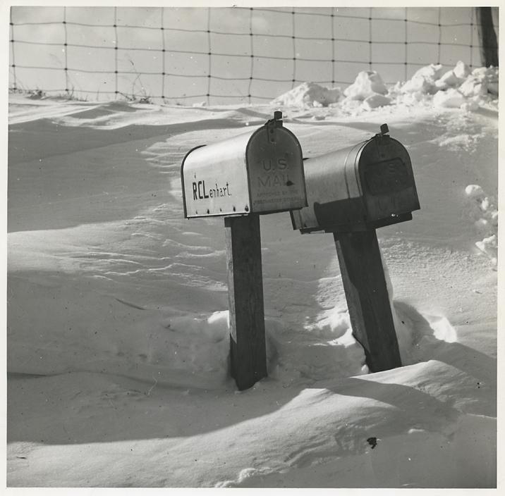 Mailboxes for farms on highway near Fredrick, Md. —Feb. 1940,   1940. Vintage Gelatin Silver Print. FSA credit stamps, typed caption and negative number in pencil on verso. Image measures 7 5/8 x 7 5/8. Inventory #C1609.  Terms     Inquire