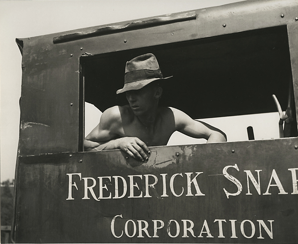 """Untitled,     [Man in Tractor]   ca. 1938. Vintage gelatin silver print. Image measures 7 x 8 5/8 inches. Credited """"P. Ingemann Sekaer 217 W. 14"""" in pencil on mount verso. Inventory #PS0713.  Terms  