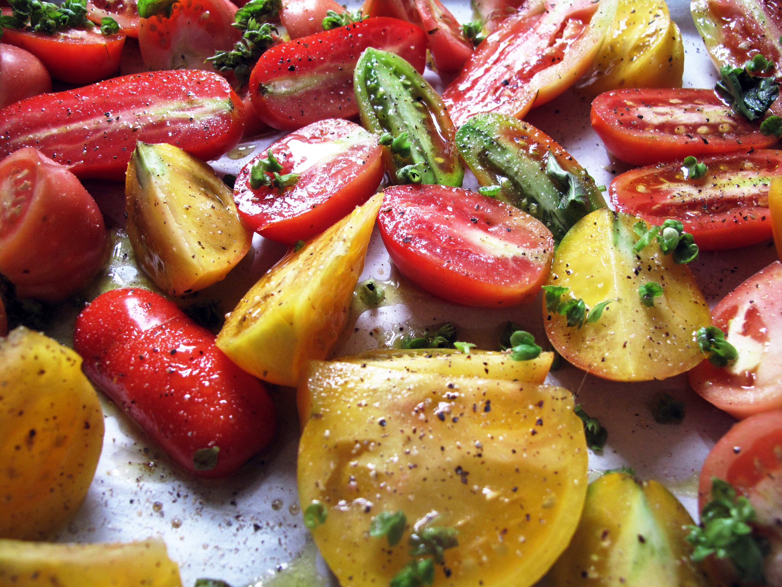 Heirloom tomatoes fresh from my garden are ready for a good roast in a hot oven.