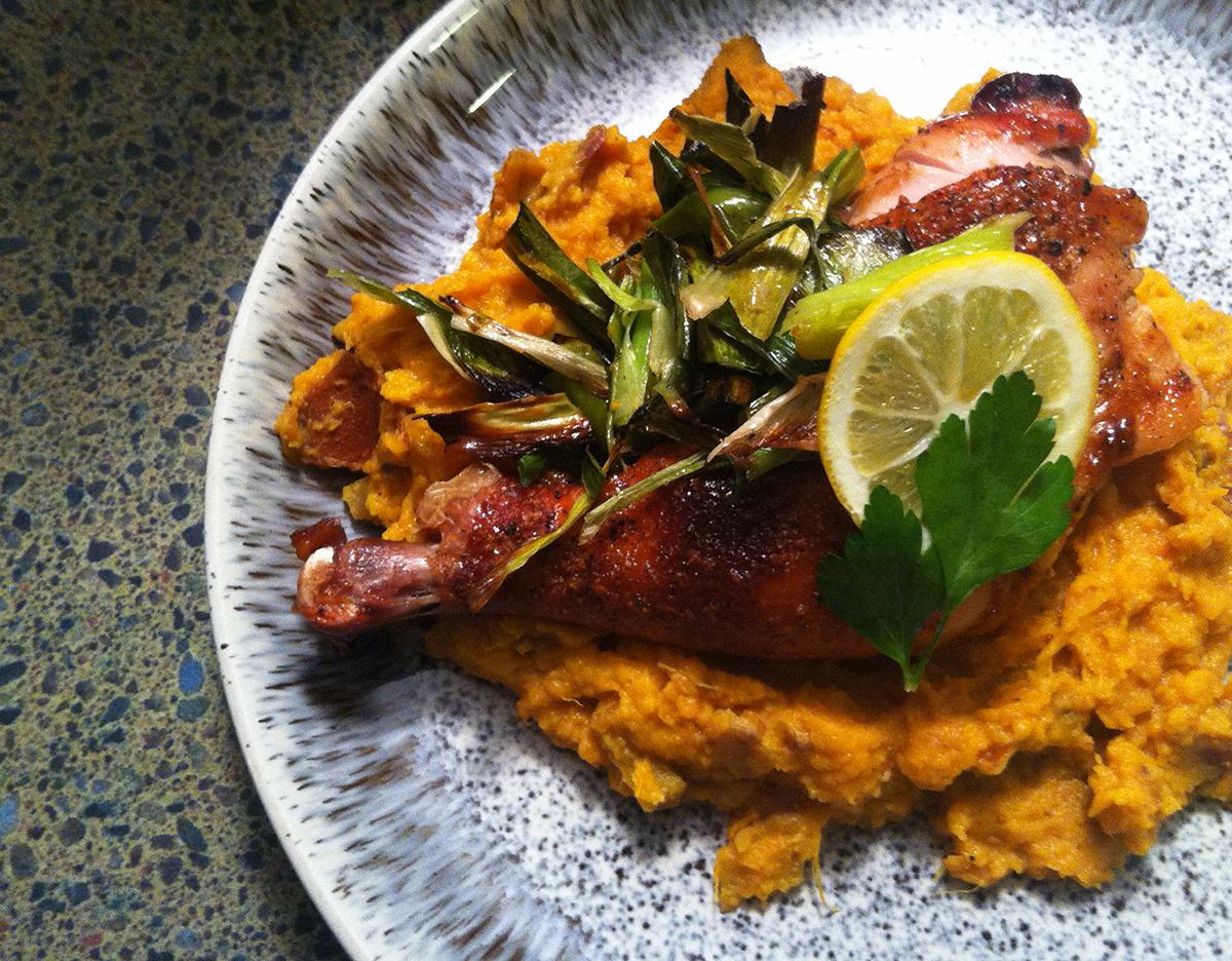 Honey bourbon glazed chicken with smashed sweet potatoes, charred leeks, meyer lemon.