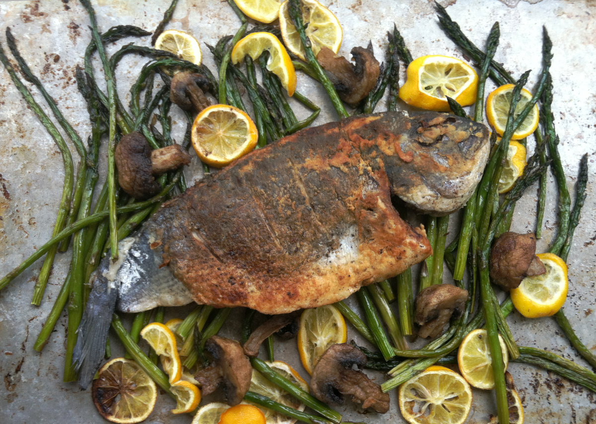 Whole crispy fish with roasted asparagus and lemon. - Rachel Weston