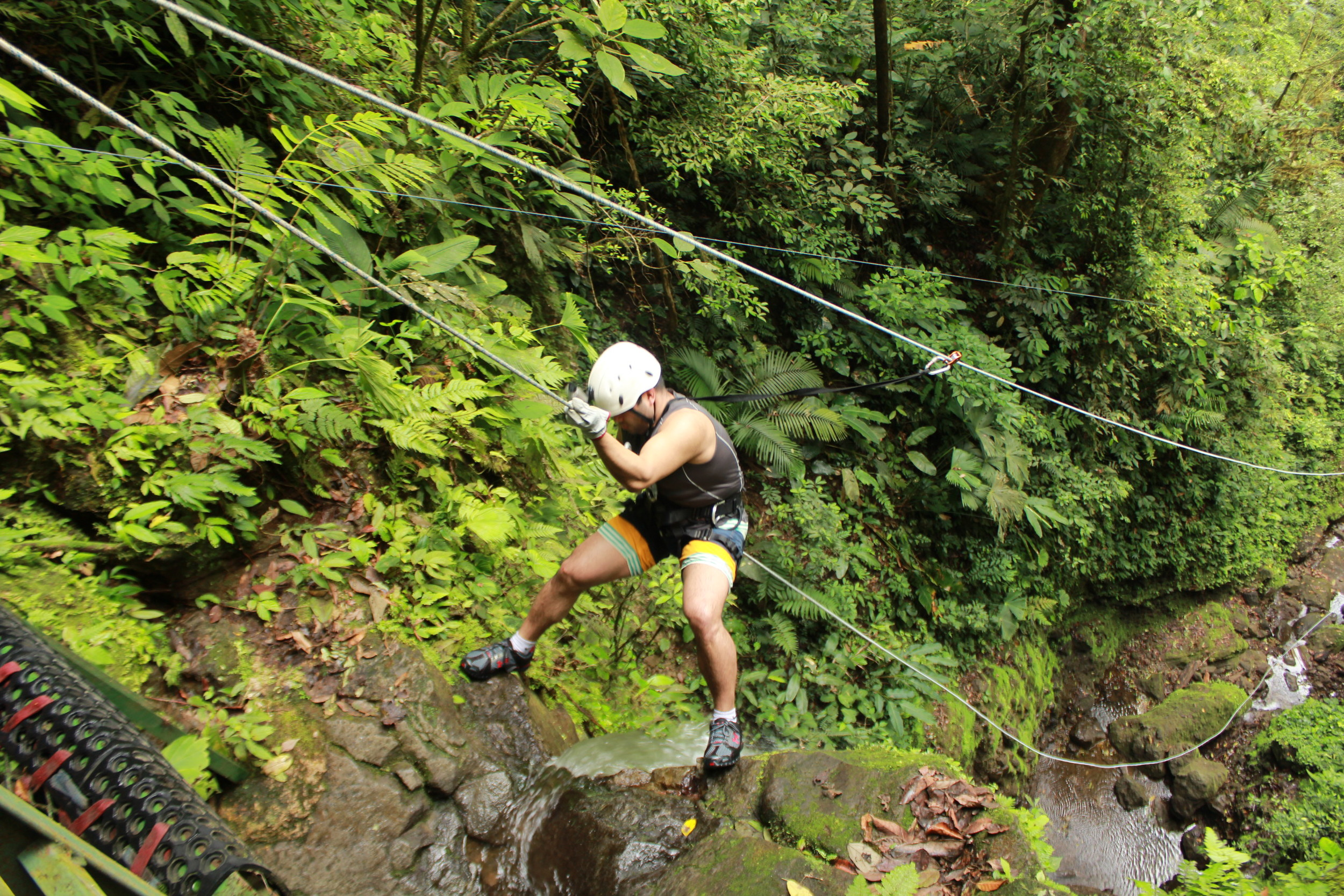 Costa Rica, 2013. Slipping off the cliff without a proper security harness.