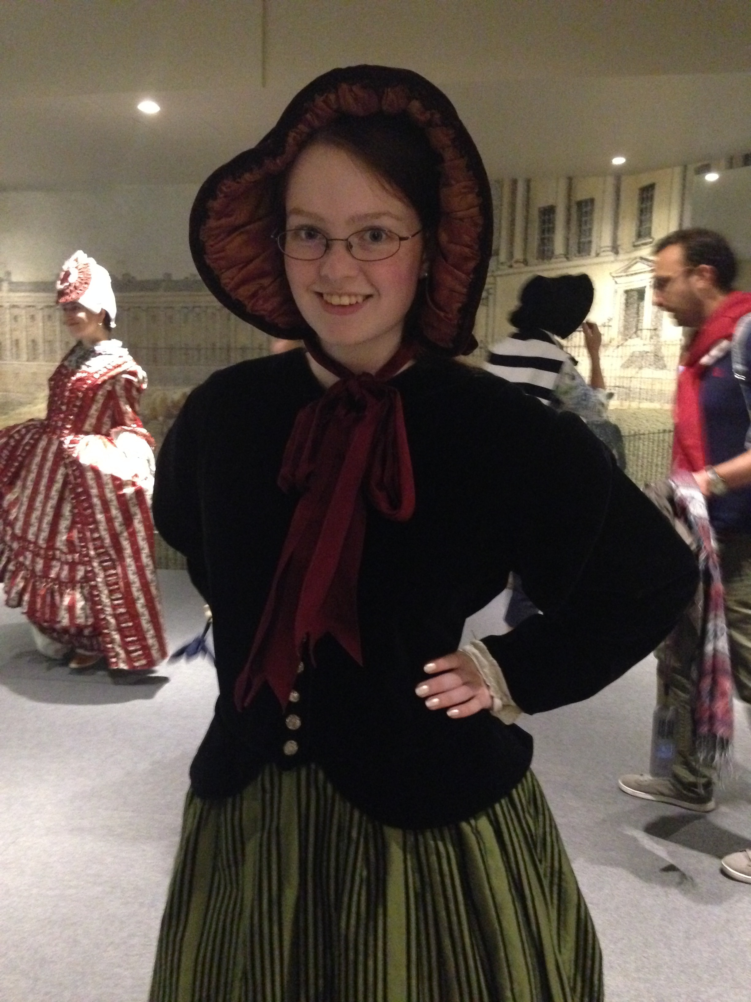 Me in some sort of 19th-century garb, with a bonnet.