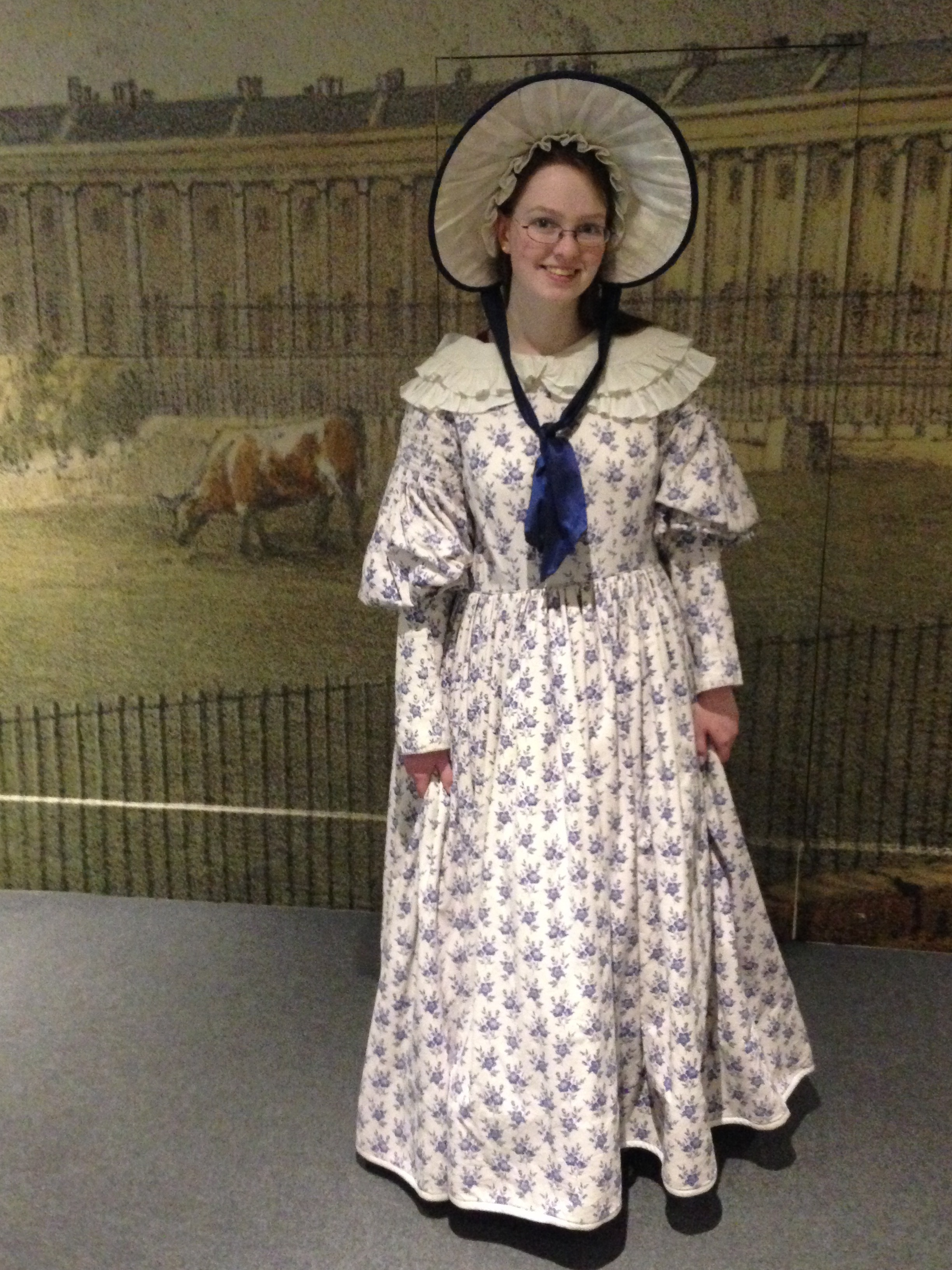Me in a 19th-century dress and bonnet.