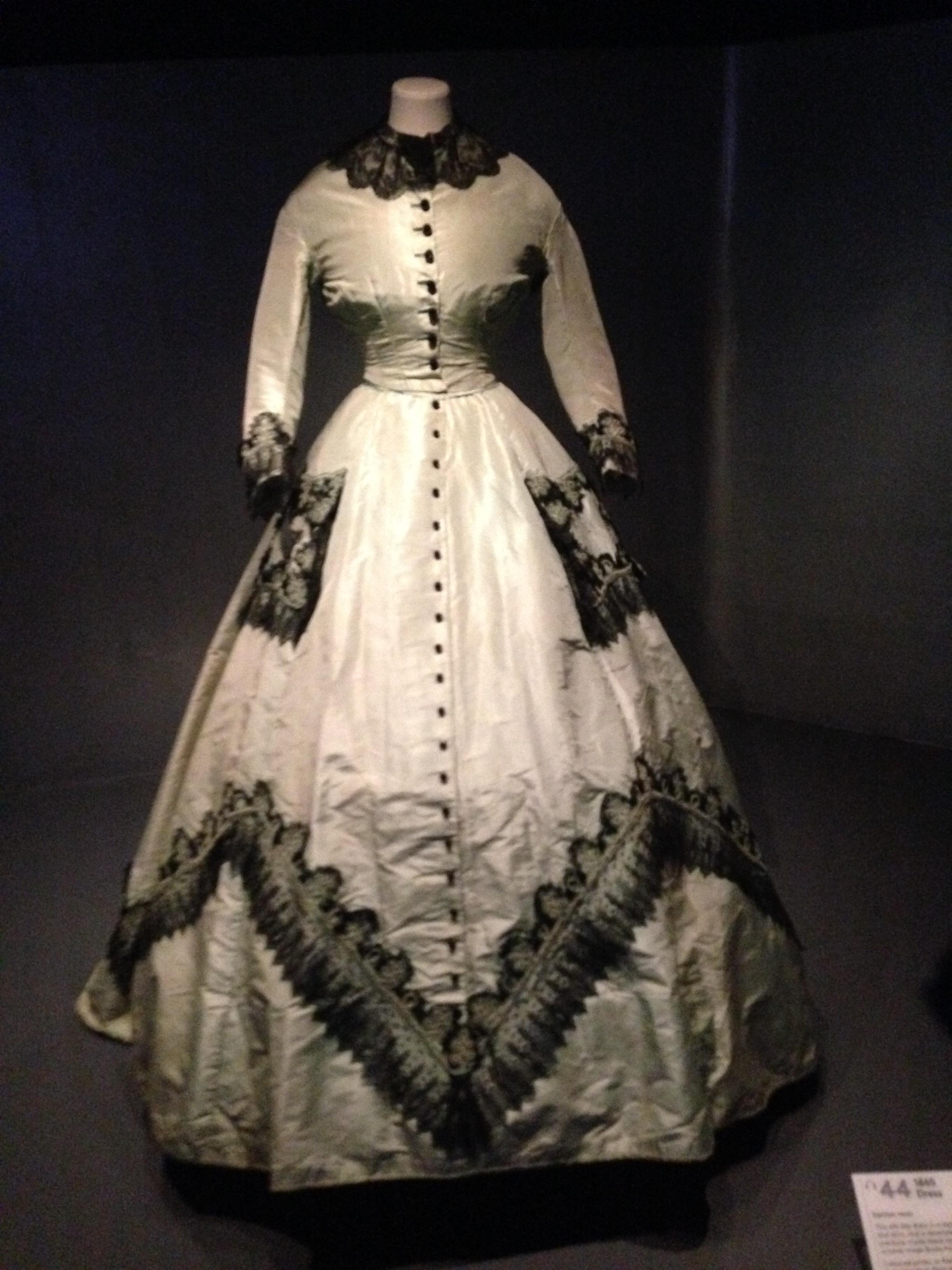 A beautiful light green Victorian dress.