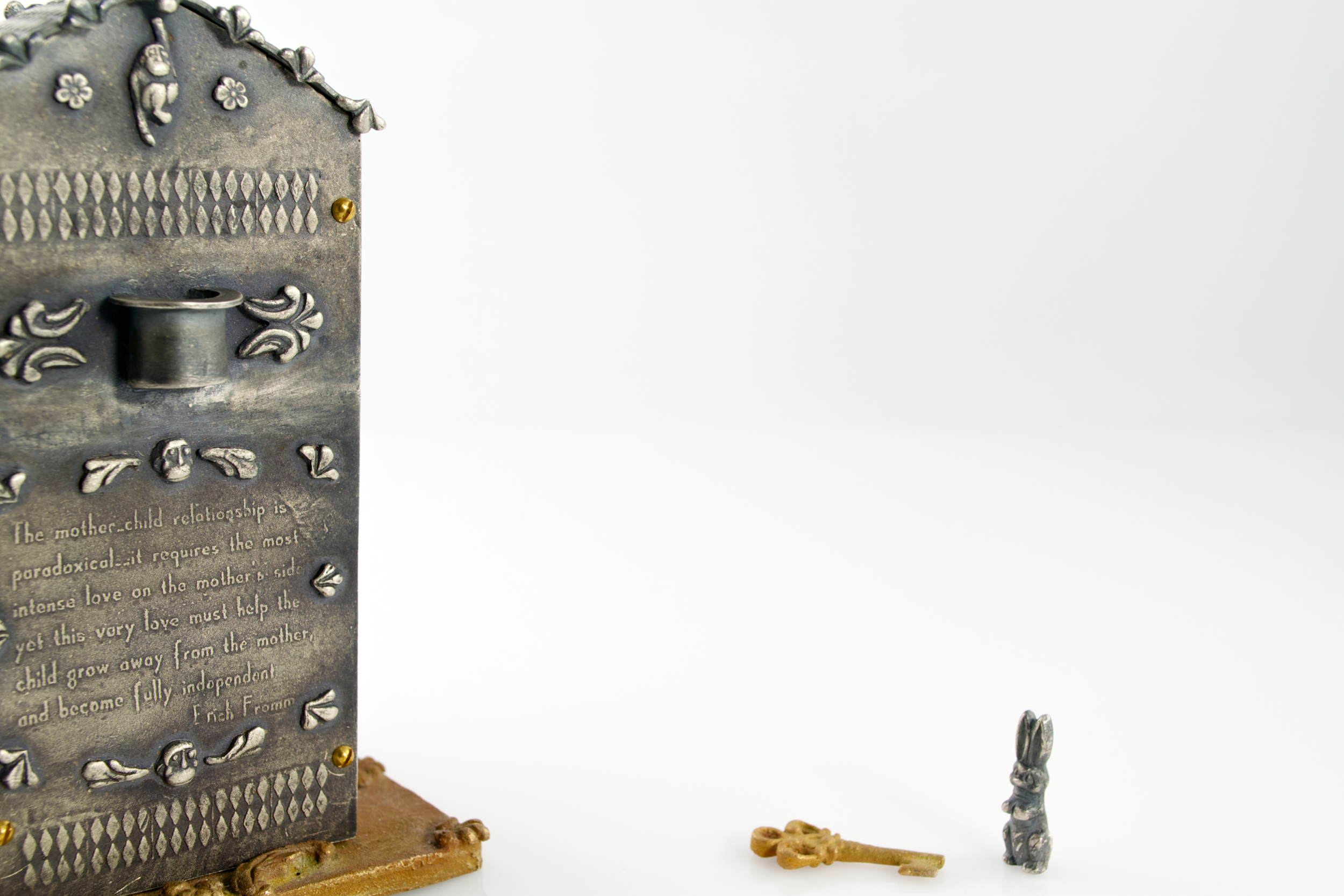 Reliquary of childhood memories (reverse)  ; silver, bronze, brass, local cotton, India ink; 2012-13