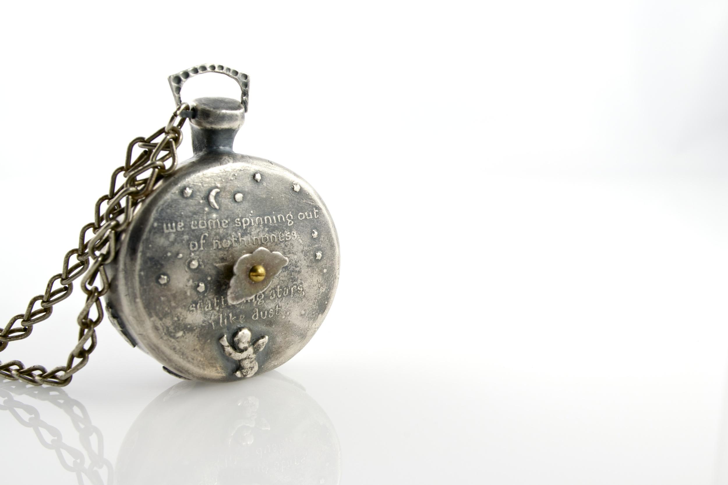 Mechanical timepiece pendant;   silver, 18k, 24k, brass, olivine, found object; 2012-13