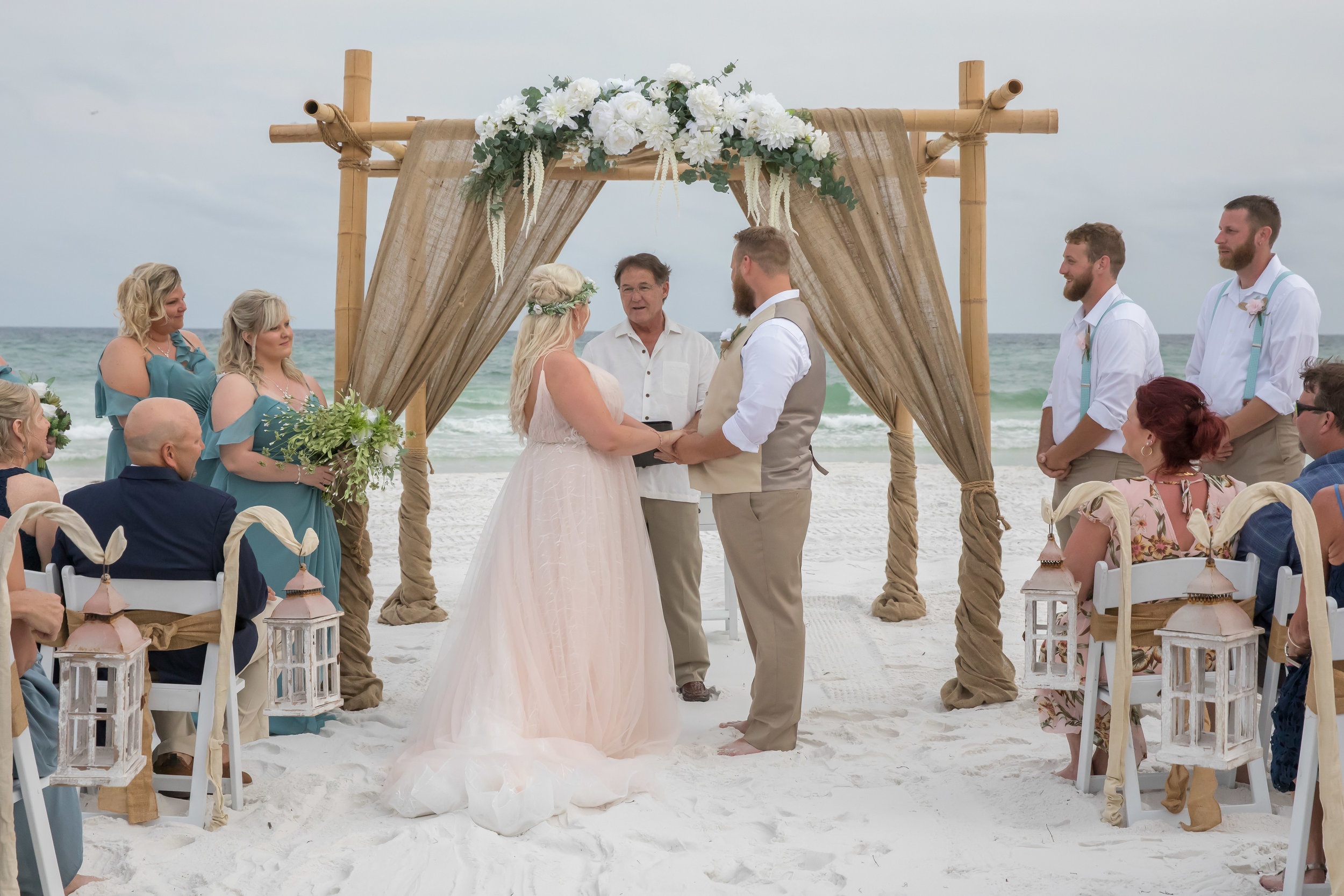This burlap arbor can be used upon request. this white custom floral arrangement may be added for additional fee.