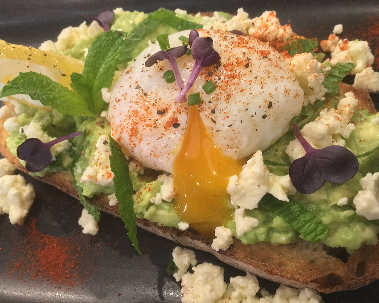 Smashed Avocado - on toast with mint, feta cheese, black pepper and a poached egg